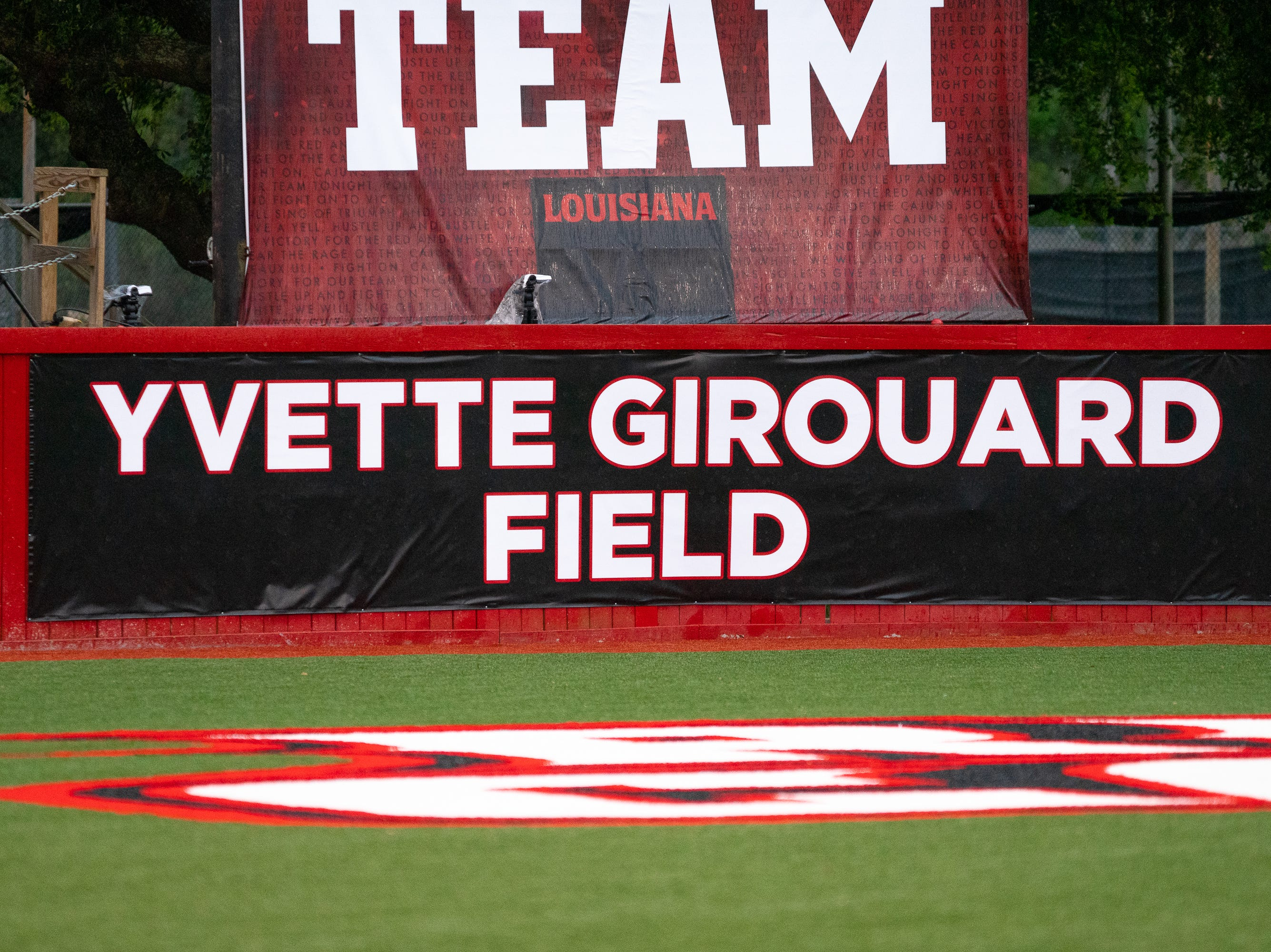 A sign of the newly named field dedicated to former UL softball coach Yvette Girouard is on display as the Ragin' Cajuns take on the Troy Trojans at Lamson Park, Yvette Girouard Field on Friday, March 15, 2019.