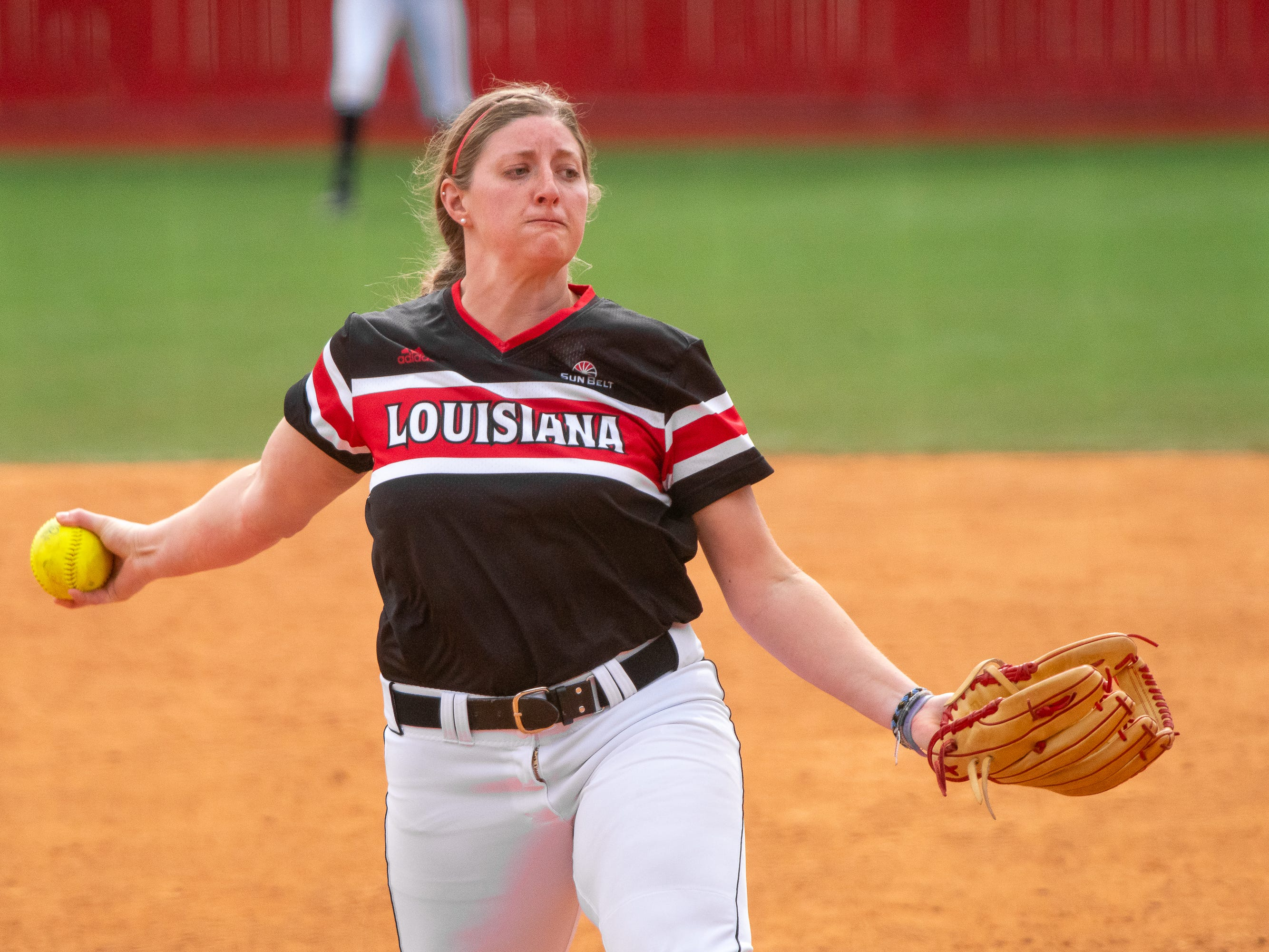 UL's Carrie Boswell throws a pitch as the Ragin' Cajuns take on the Troy Trojans at Yvette Girouard Field at Lamson Park on Saturday, March 16, 2019.