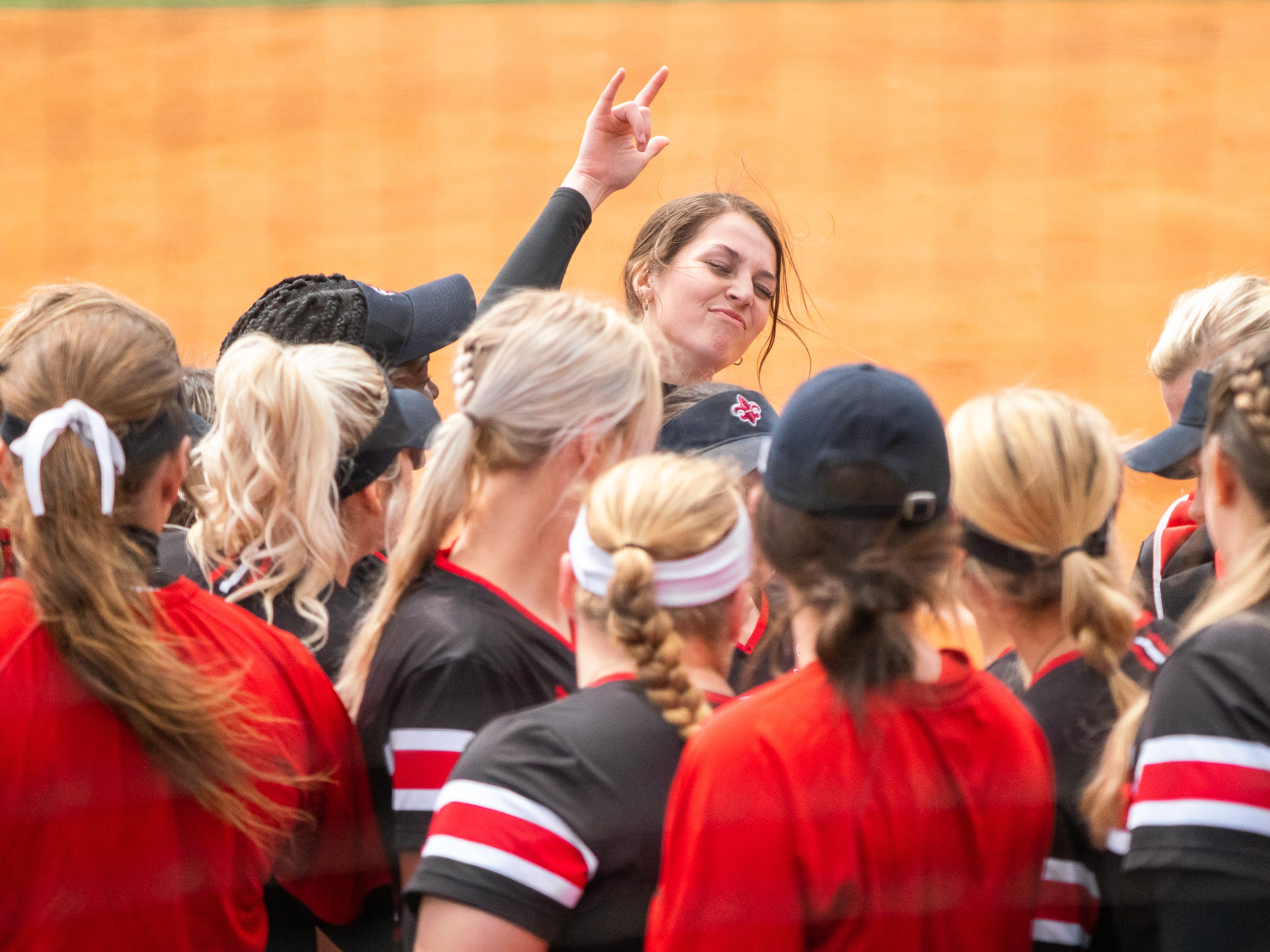 UL's softball team celebrates in between innings as the Ragin' Cajuns take on the Troy Trojans at Yvette Girouard Field at Lamson Park on Saturday, March 16, 2019.