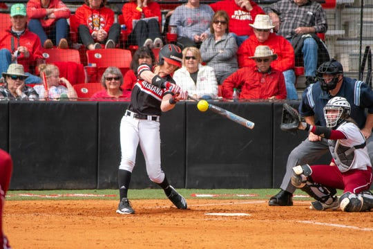 UL's Sarah Hudek hits a home run as the Ragin' Cajuns take on the Troy Trojans at Yvette Girouard Field at Lamson Park on Saturday, March 16, 2019.
