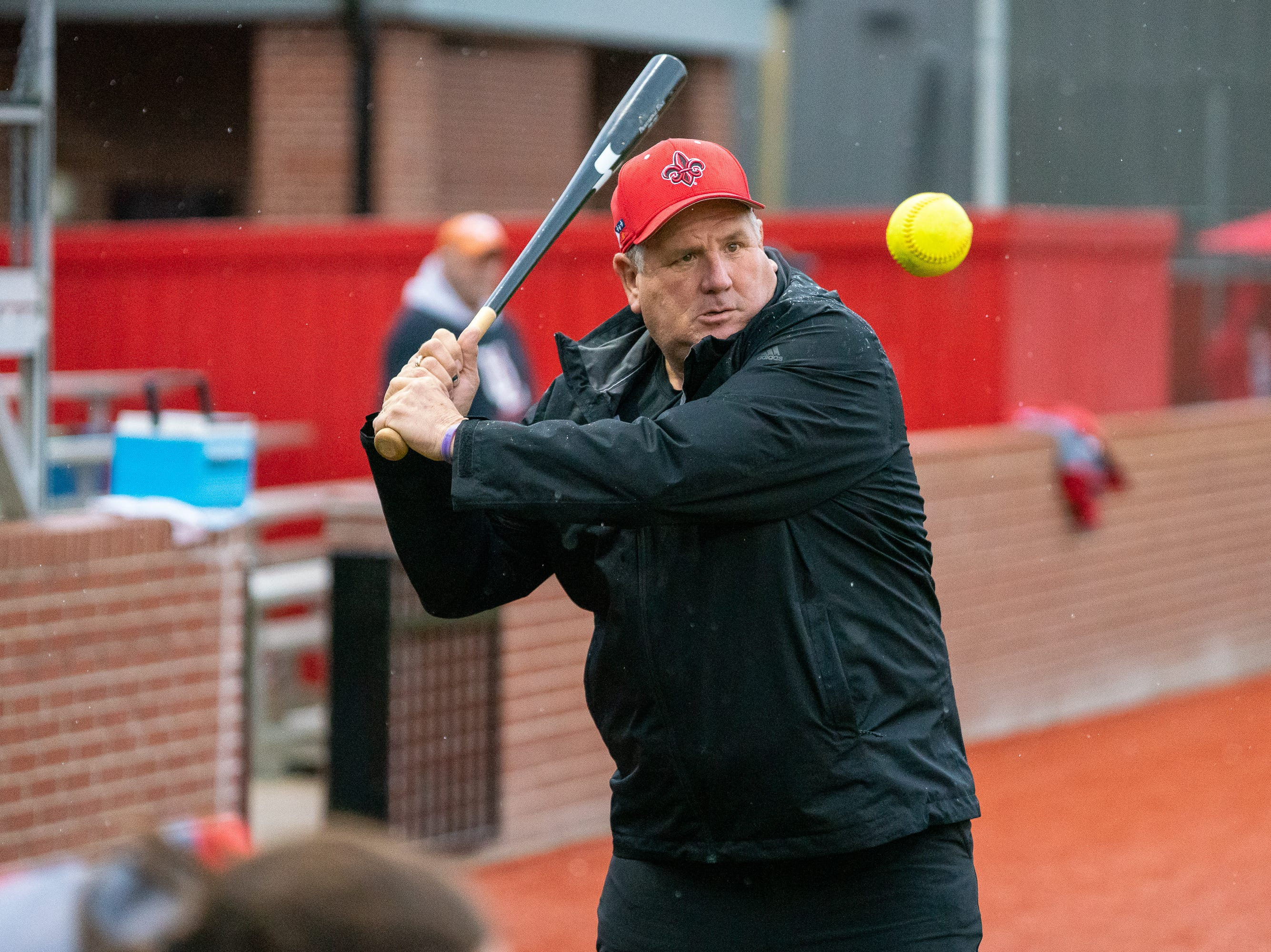 UL's head softball coach Gerry Glasco hits balls to his players before the game as the Ragin' Cajuns take on the Troy Trojans at Lamson Park, Yvette Girouard Field on Friday, March 15, 2019.