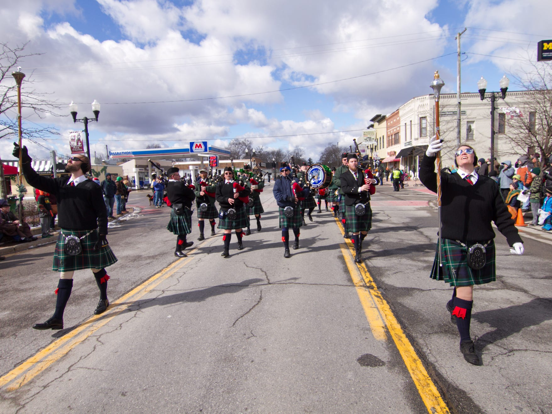 The Flint Scottish Pipe Band performs at the St. Patrick's Day parade Saturday, March 16, 2019.