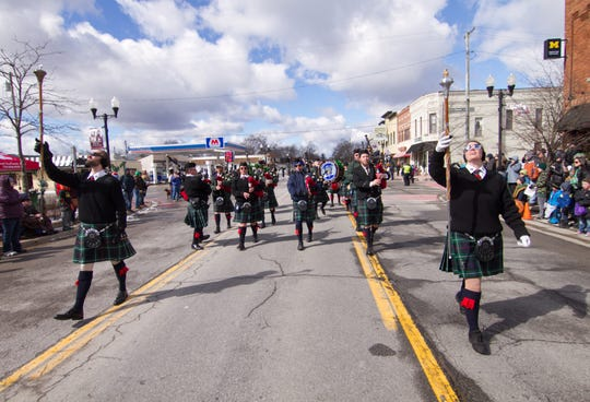 The Flint Scottish Pipe Band performs at the St. Patrick's Day parade Saturday, March 16, 2019. This year's parade was cancelled due to coronavirus concerns.