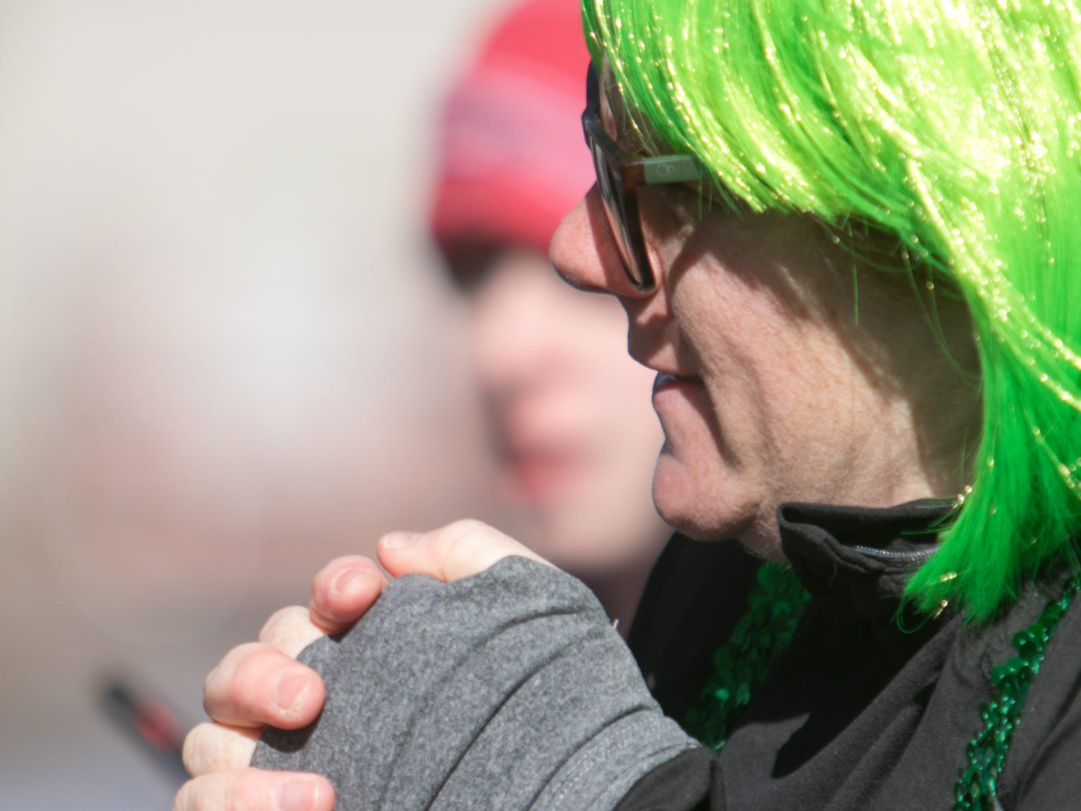 Grace Savercool warms her hands as she listens to the awards being announced after the Run for the Gold Saturday, March 16, 2019. Savercool placed second in her age group.