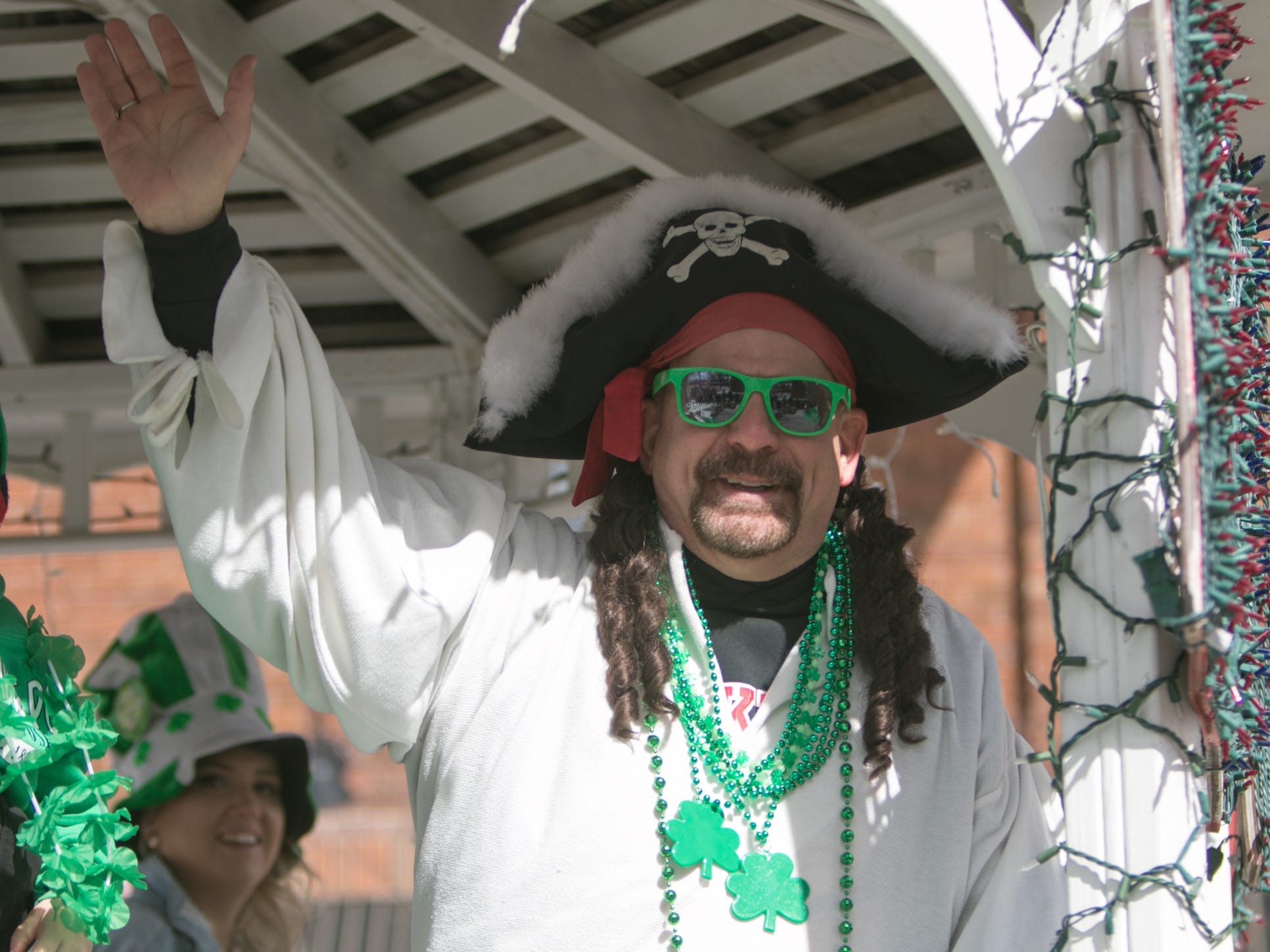 "Pinckney ""Pirate"" Rick Beaudin asks the crowd at the St. Patrick's Day parade Saturday, March 16, 2019 ""Arrrrghhh you Irish?"""