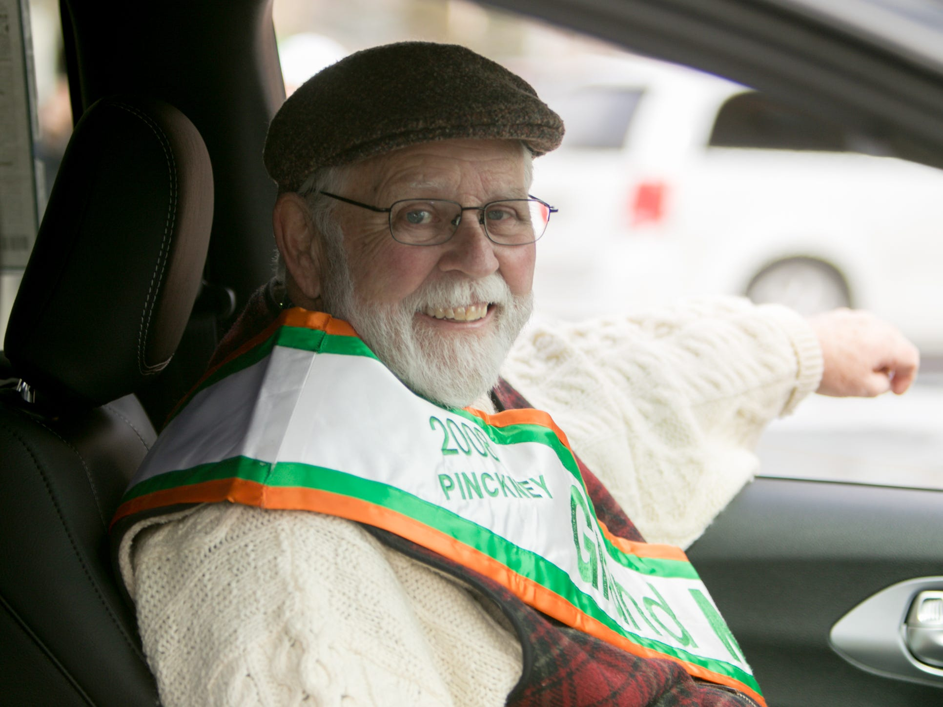 Pat Carney, 2008 grand marshal, rides in the St. Patrick's Day parade Saturday, March 16, 2019.