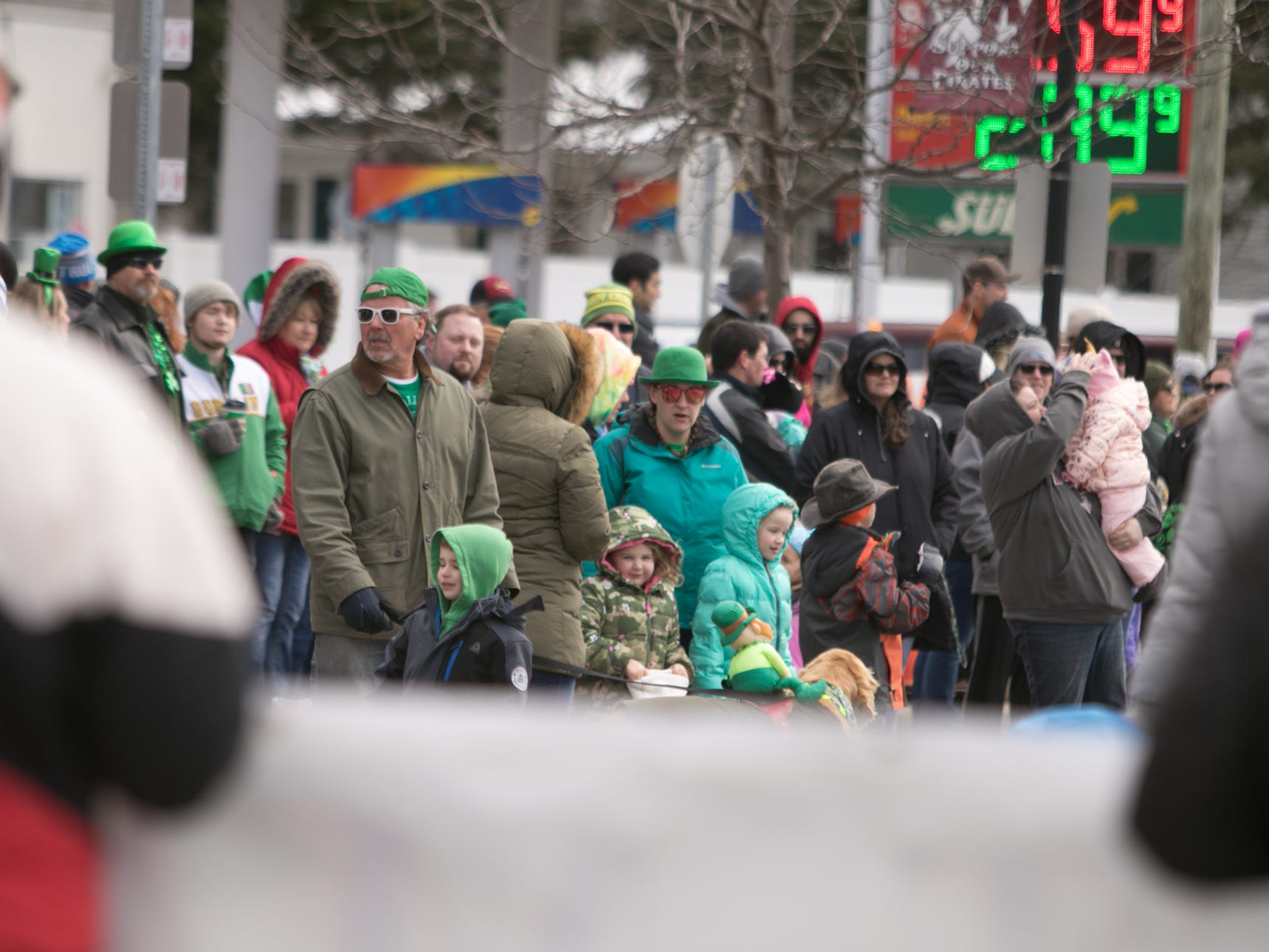 Crowds line Main St. in downtown Pinckney for the annual St. Patrick's Day parade Saturday, March 16, 2019.
