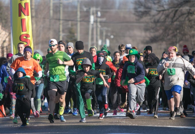 The Run for the Gold 5k run, sponsored by Light of the World Academy, gets underway before the St. Patrick's Day parade Saturday, March 16, 2019.