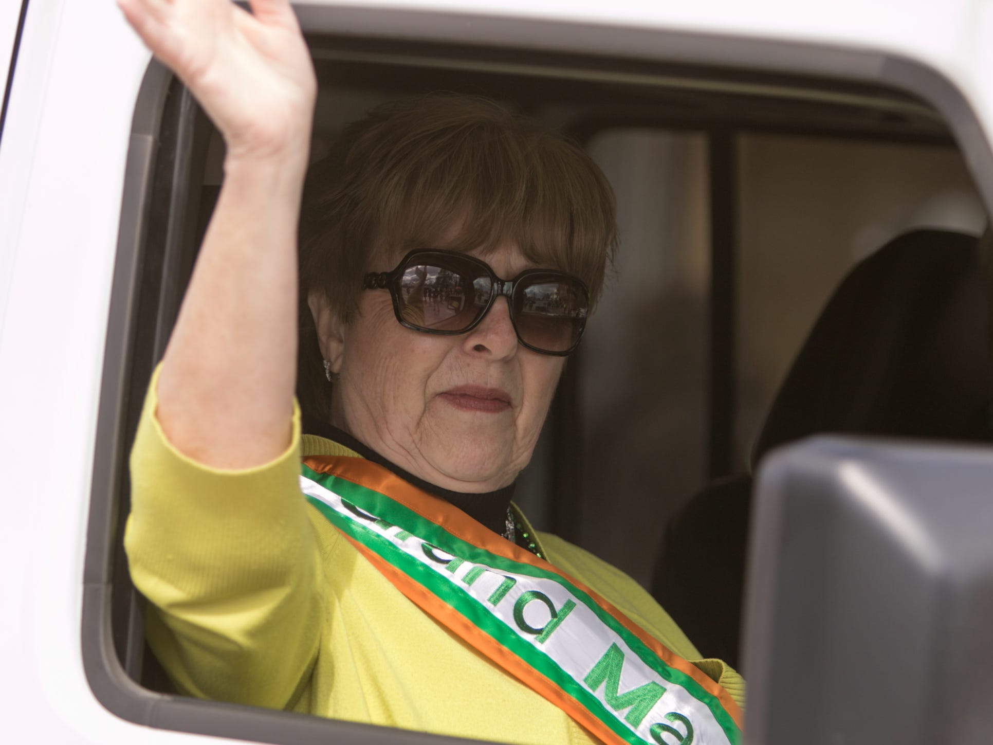 The 2009 Pinckney St. Patrick's Day parade grand marshal Linda Wallace rides in the 2019 parade Saturday, March 16, 2019.