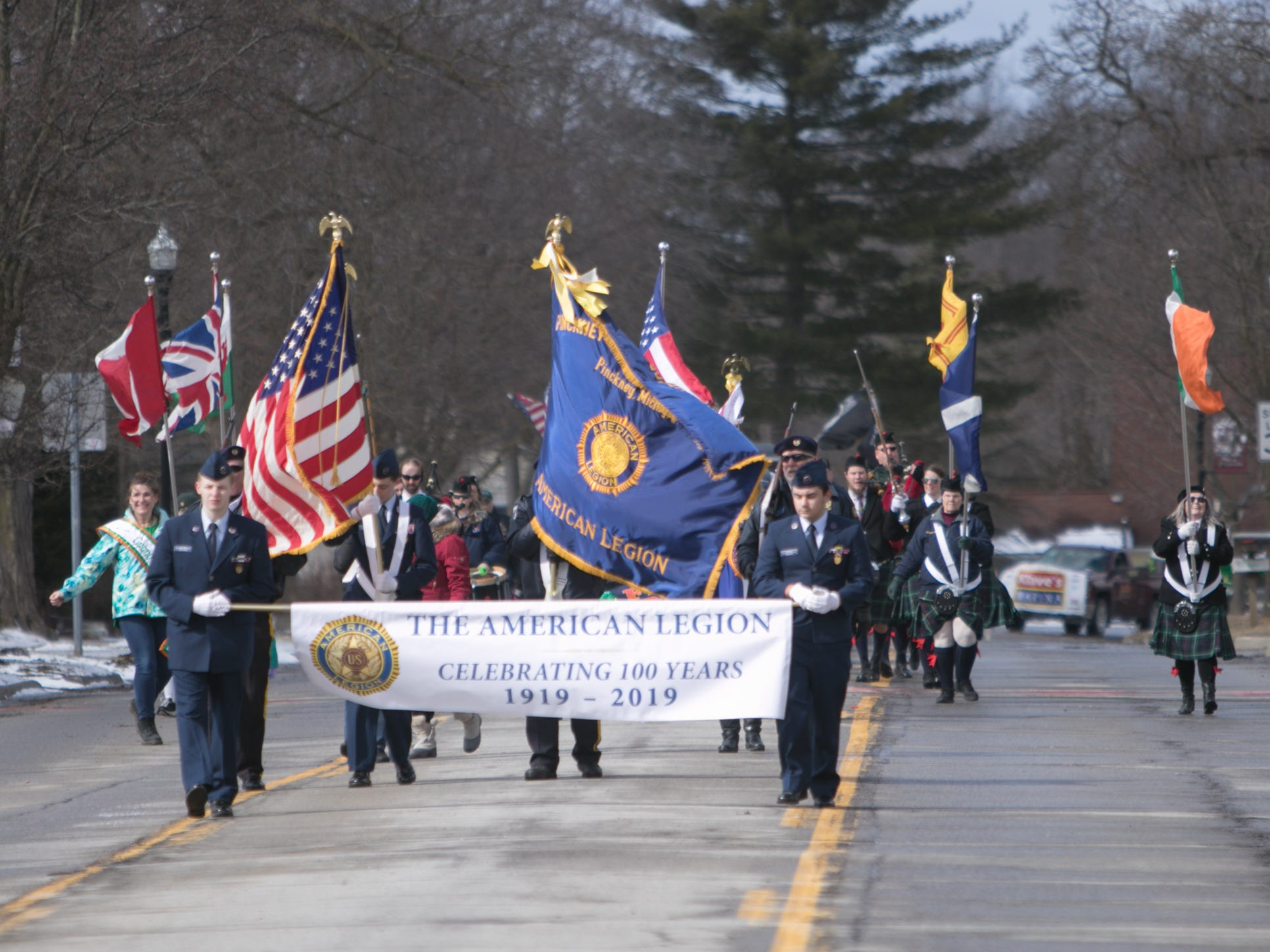 The American Legion Post 419 leads the Pinckney St. Patrick's Day parade Saturday, March 16, 2019.