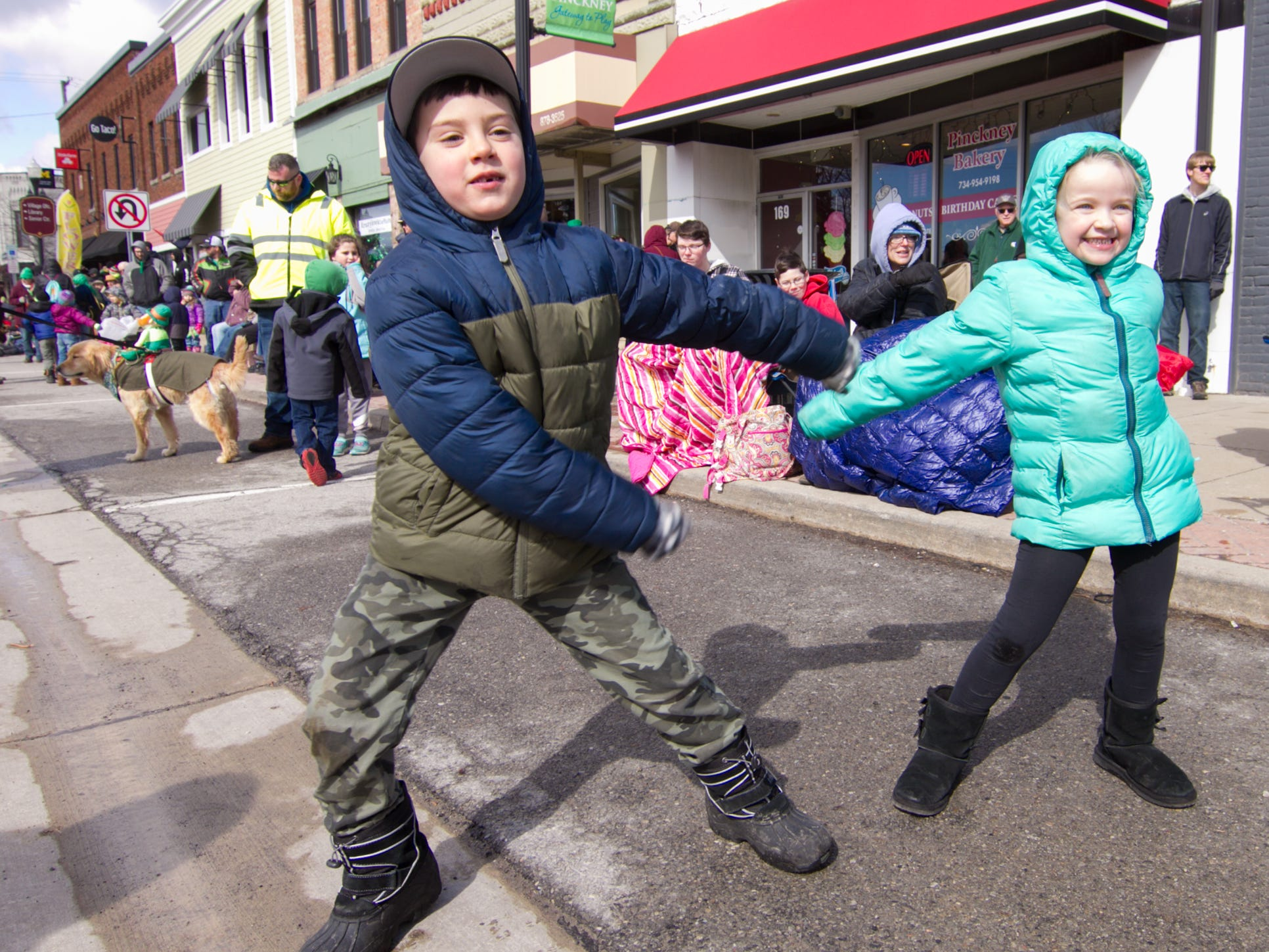 "Oliver Aschenbrenner and Chloe Tolbert perform ""The Floss"" as they await the start of the St. Patrick's Day parade Saturday, March 16, 2019."