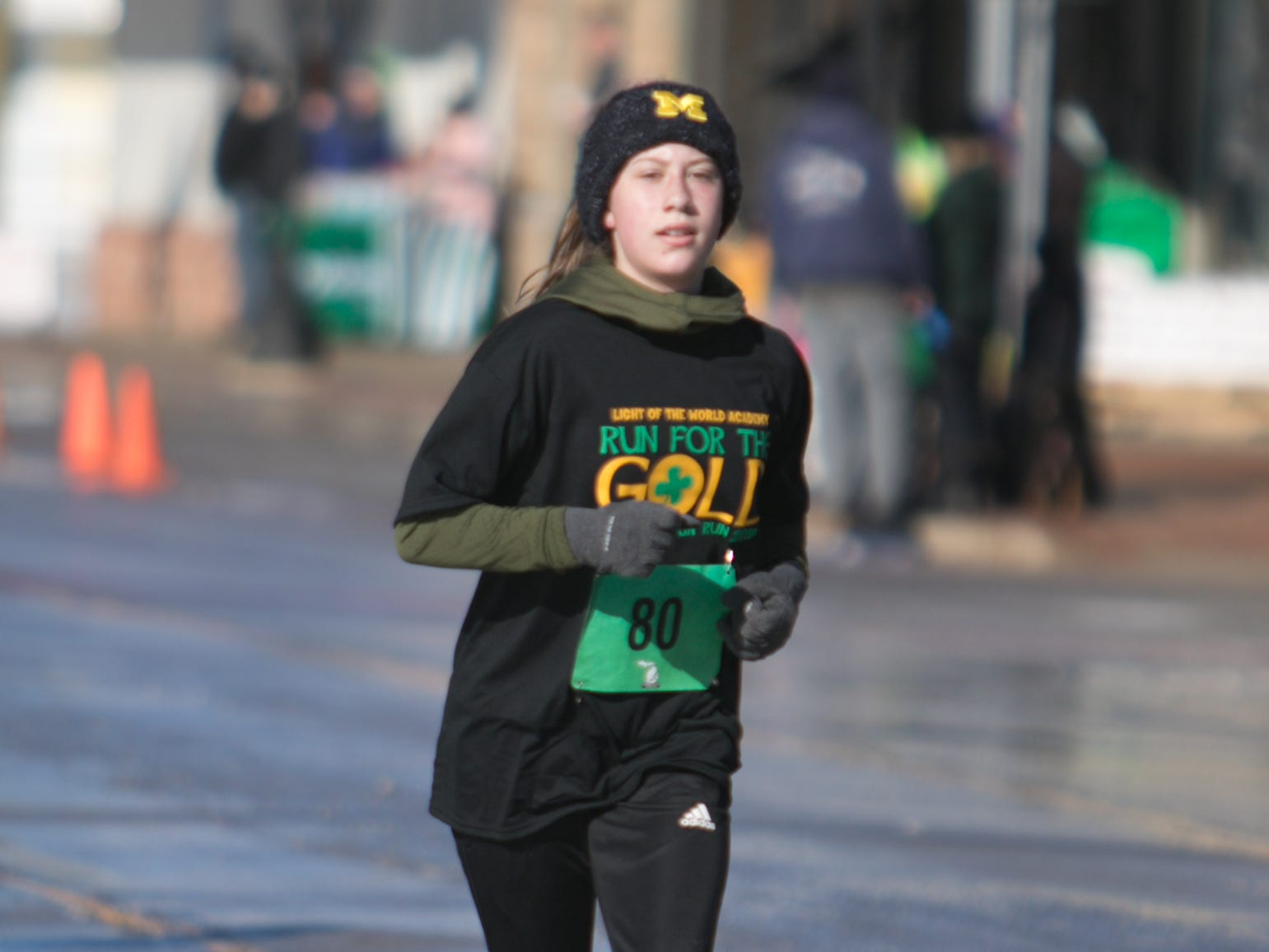 14-year-old Emma Moore, a Pinckney High School freshman, was the first female finisher of the Run for the Gold 5k Saturday, March 16, 2019.
