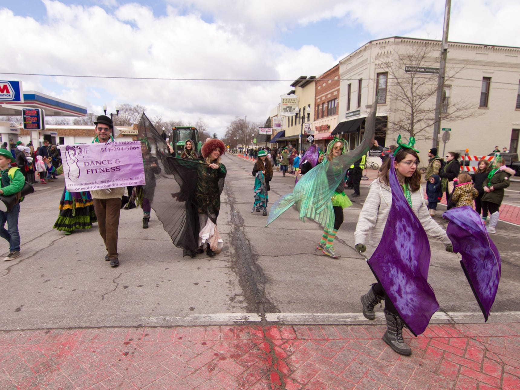One Spirit Dance and Fitness walks in the St. Patrick's Day parade Saturday, March 16, 2019.