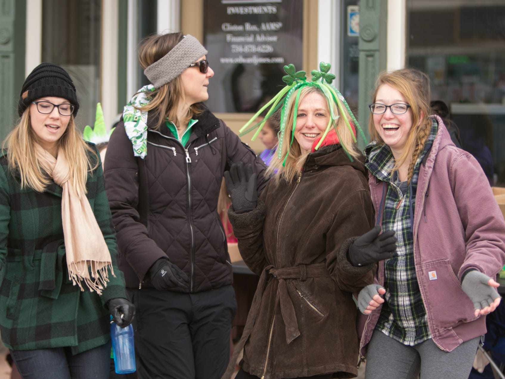 "From left, Danielle Queener, Marissa Nolan, Staci Fordham and Carol Johnson dance to Will Smith's ""Gettin' Jiggy Wit It,"" played by Ron Tennyson who emceed the St. Patrick's Day parade Saturday, March 16, 2019."