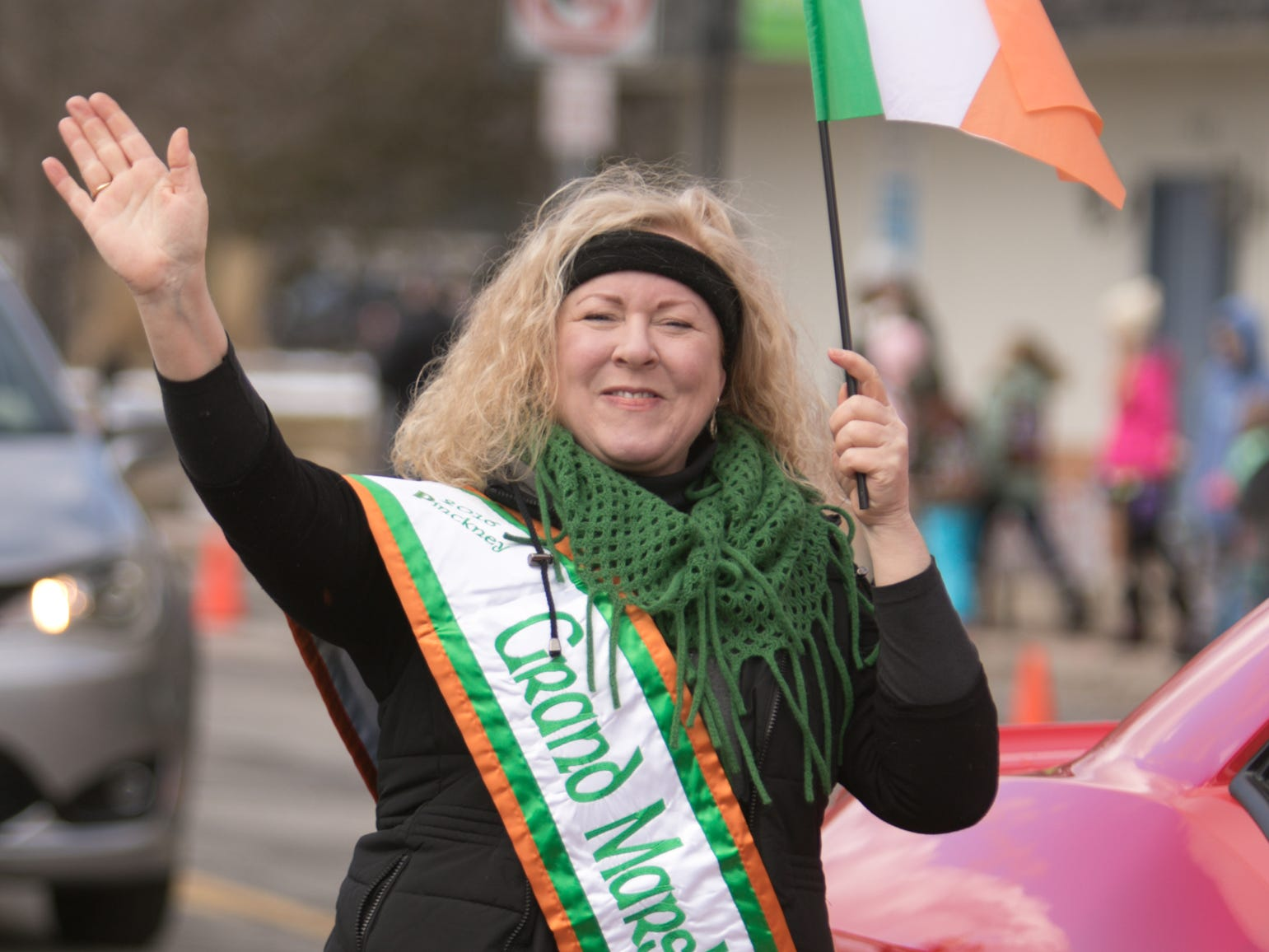 Anne Lezotte, president of the Sarah Regan division of the Ladies Ancient Order of Hibernians and 2016 grand marshal, walks in the Pinckney St. Patrick's Day parade Saturday, March 16, 2019.