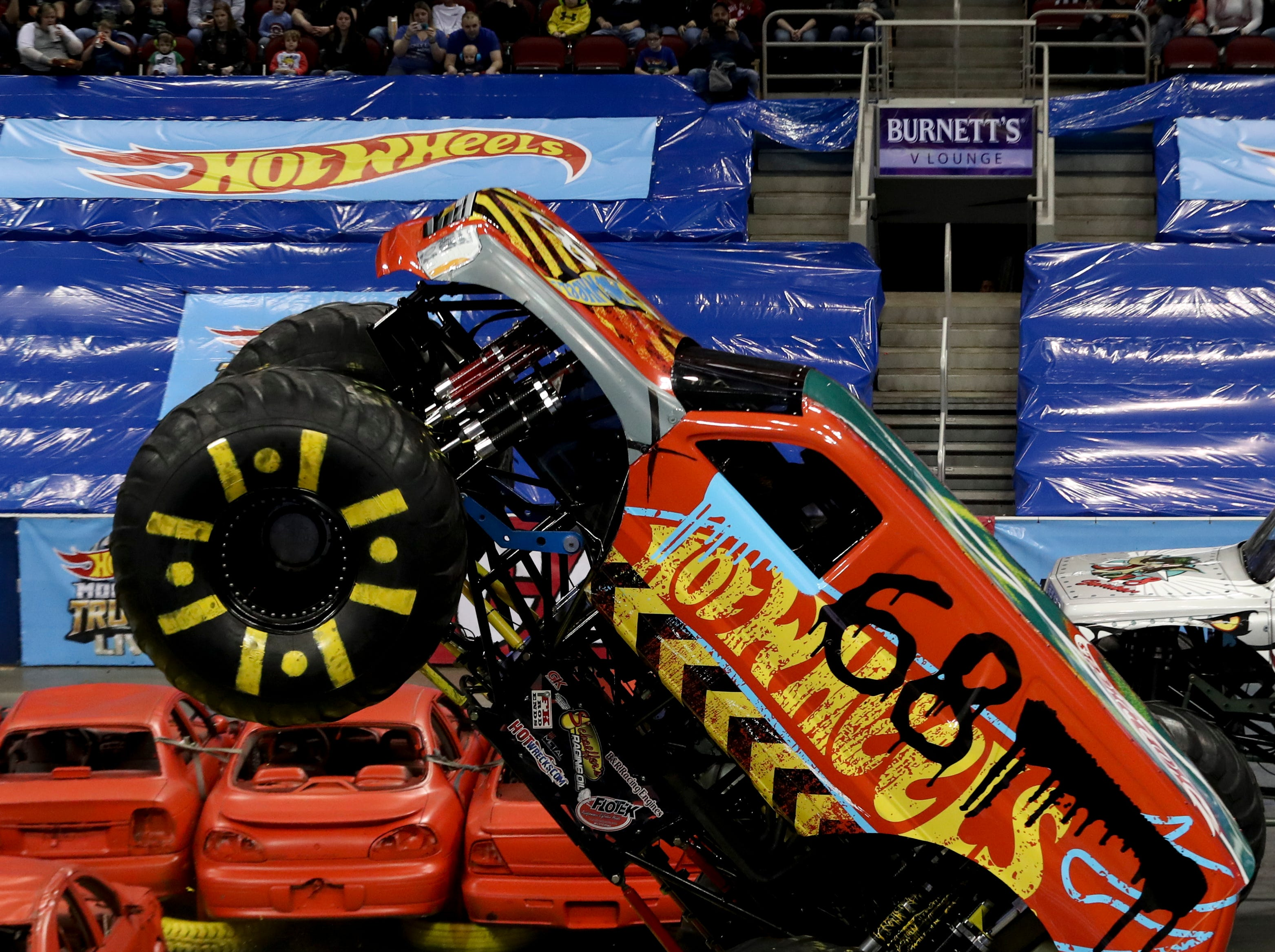 Louisville local Derick Anson, driver of Demo Derby, entertains the crowd at the Hot Wheels Monster Trucks show at the KFC Yum Center on March 16.