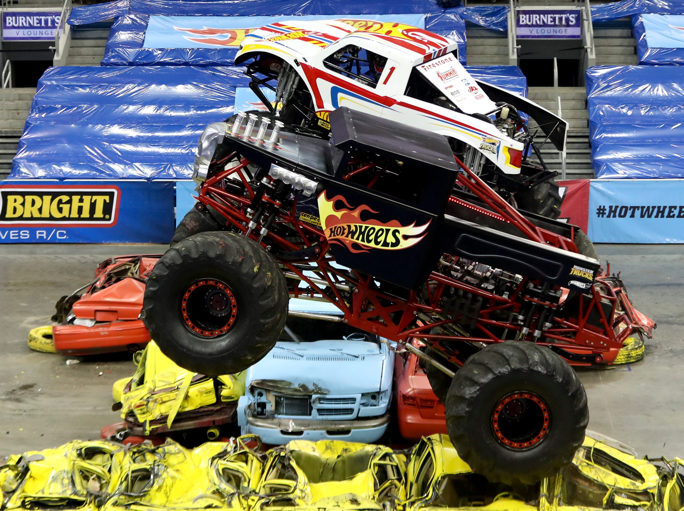 Cody Holman, driver of Bone Shaker, and Christian Norman, driver of Hot Wheels Racing #1, compete at the Hot Wheels Monster Trucks show at the KFC Yum Center on March 16.