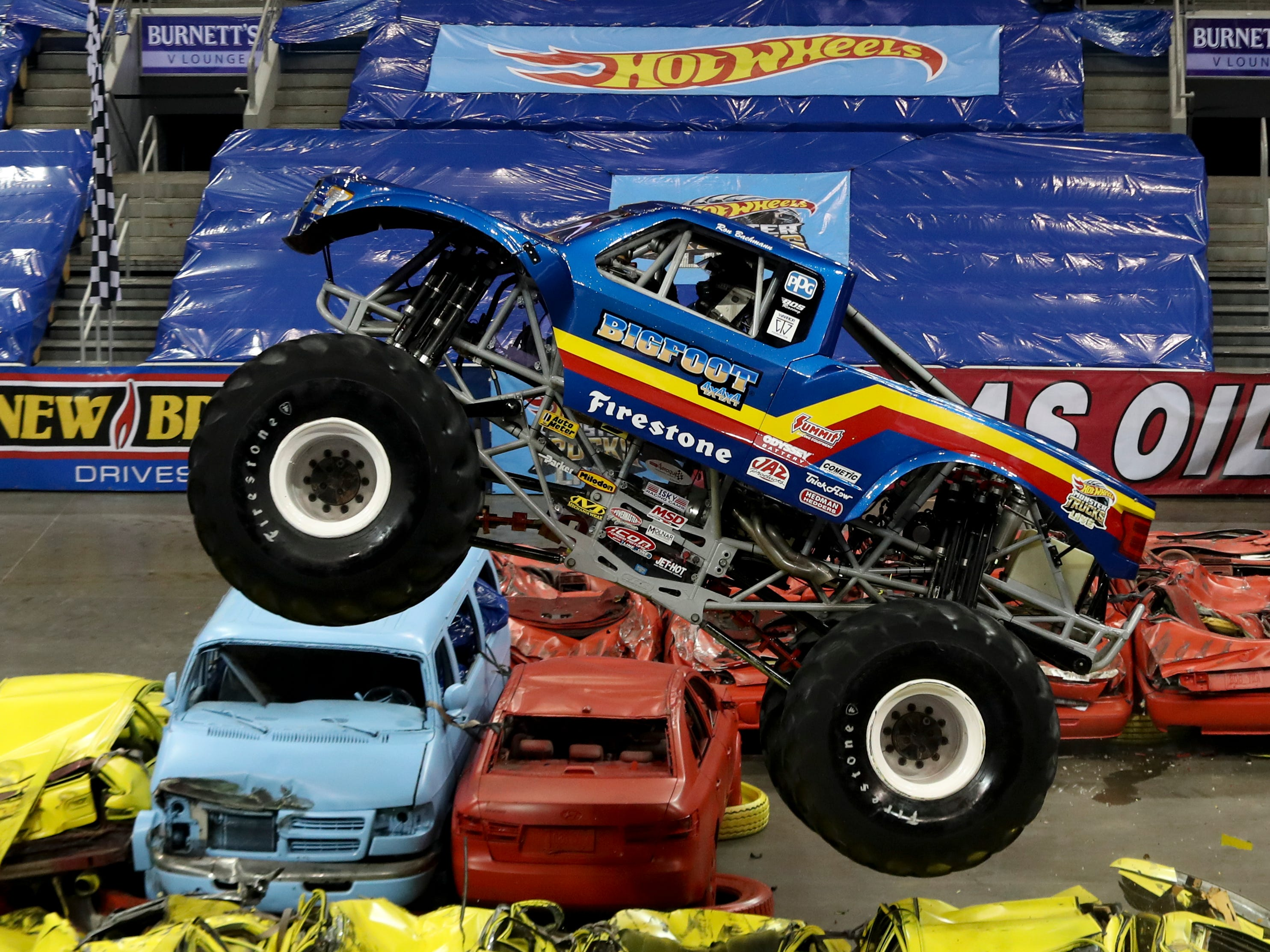 Darron Schnell, driver of Big Foot, entertains the crowd at the Hot Wheels Monster Trucks show at the KFC Yum Center on March 16.