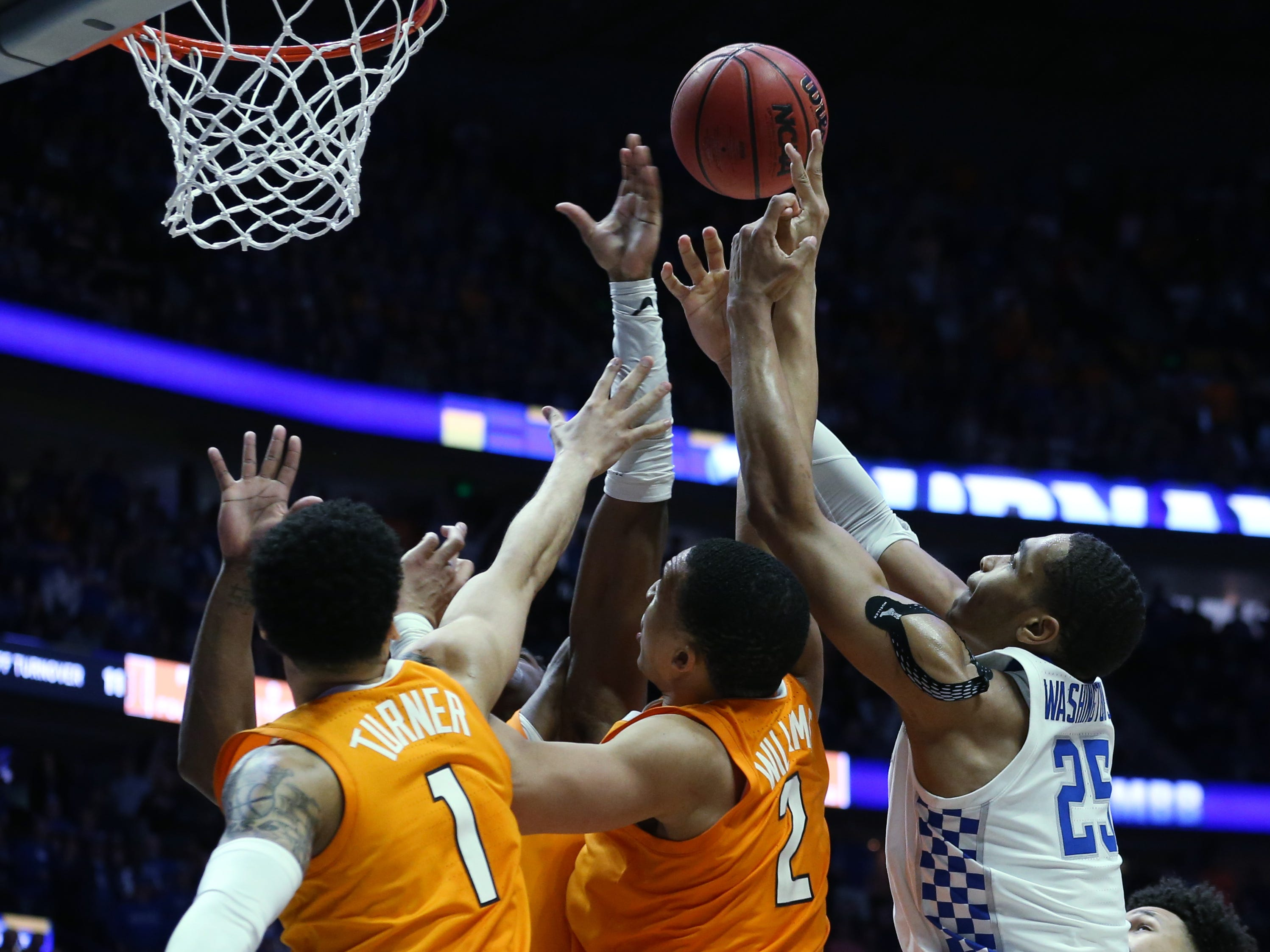 Kentucky forward PJ Washington (25), Tennessee guard Lamonte Turner (1) and Tennessee forward Grant Williams (2) try to get a rebound during the second half of the SEC Men's Basketball Tournament game at Bridgestone Arena in Nashville, Tenn., Saturday, March 16, 2019.
