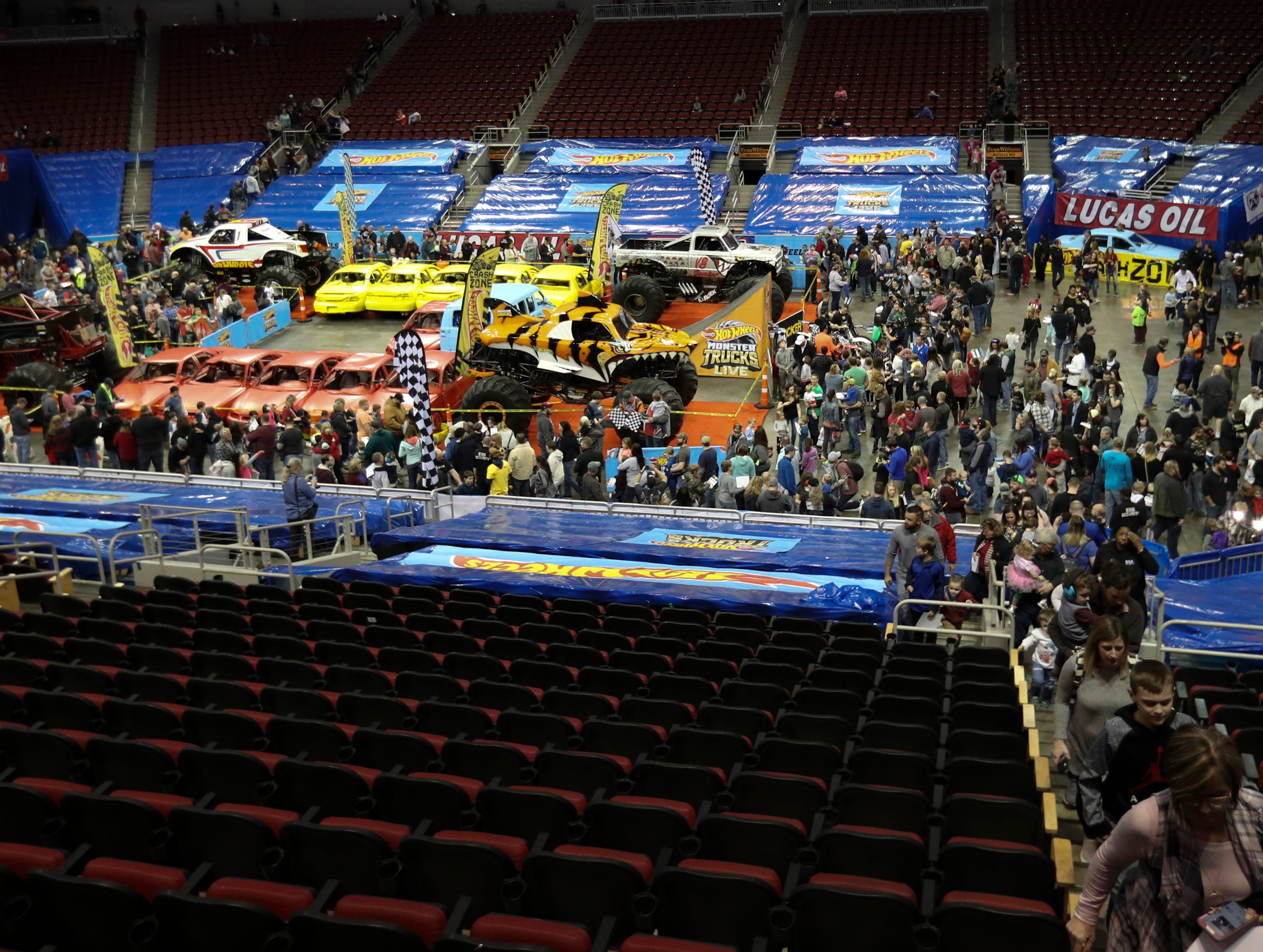 The Crash Zone Party draws a huge crowd as people get up close and personal with the trucks and their drivers before the Hot Wheels Monster Trucks show at the KFC Yum Center on March 16.