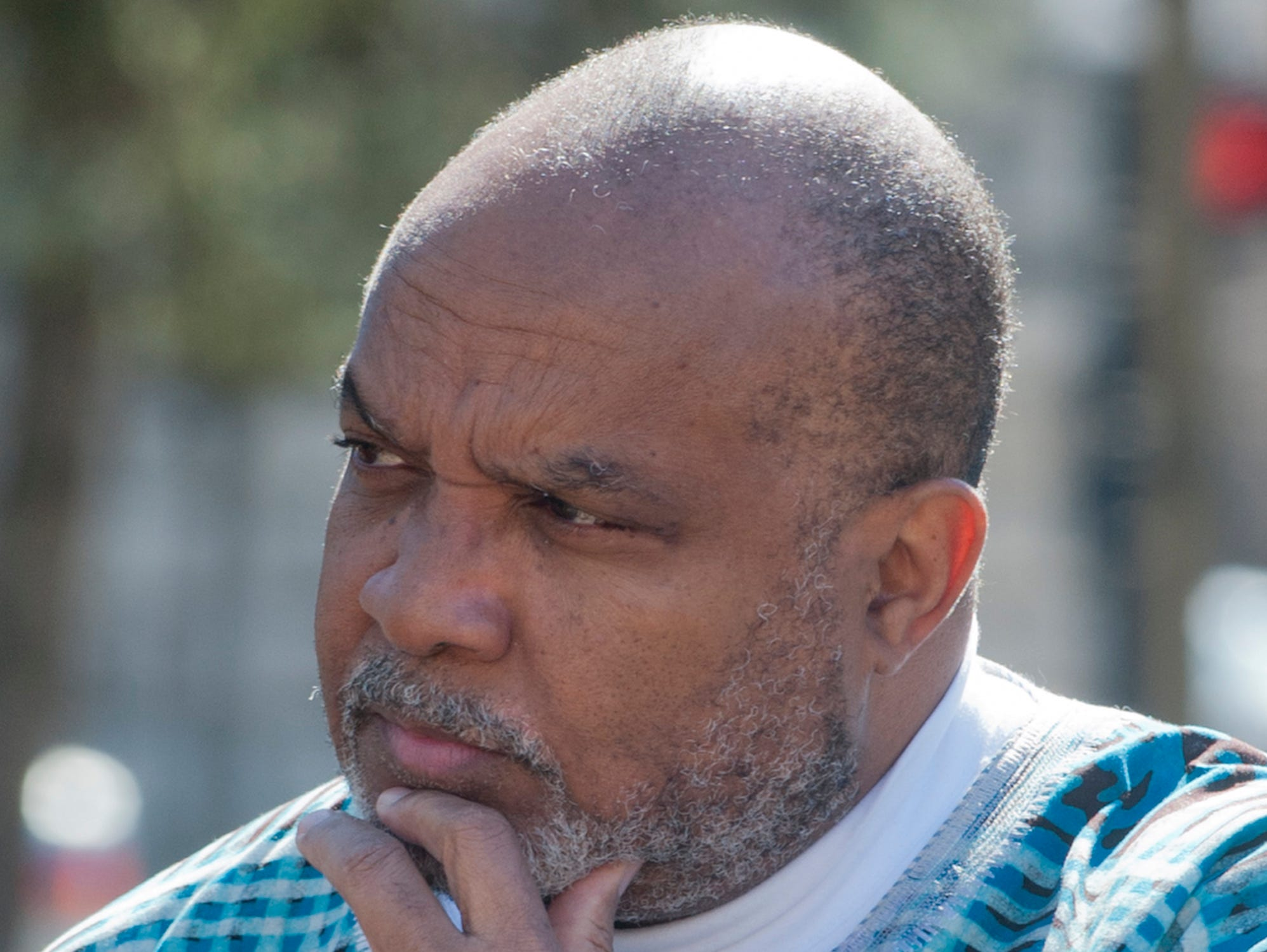 Alton Pollard, president of the Louisville Presbyterian Theological Seminary listens to a speaker at the vigil.