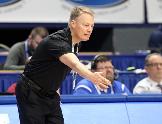 Male head coach Champ Ligon directs his team in their quarterfinal game against Barren County at the KHSAA Girl's Sweet 16, Friday, March 15. Male won 63-49.