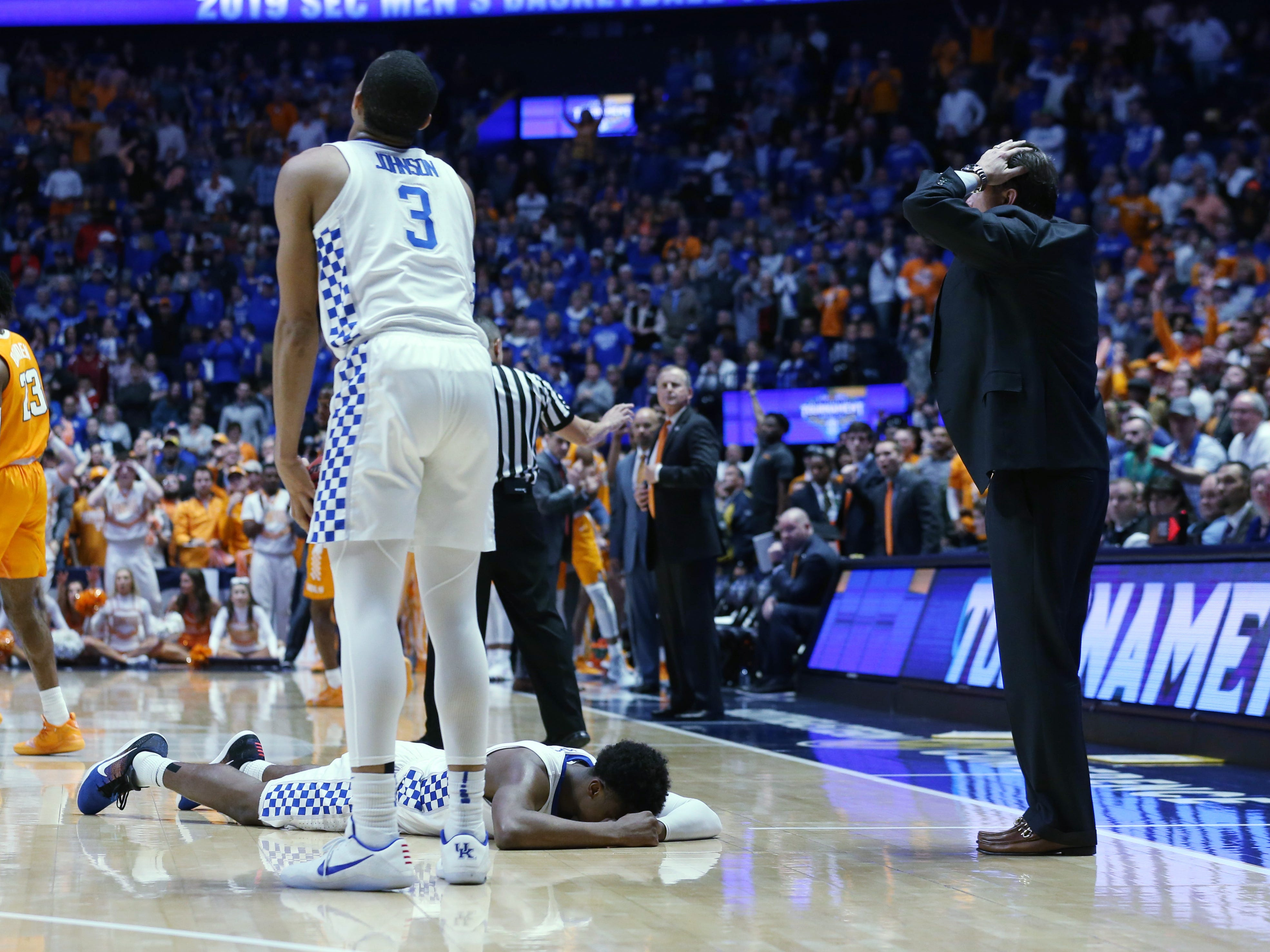 As Kentucky guard Ashton Hagans (2) lies on the court after committing a foul in the closing seconds, Kentucky head coach John Calipari is in disbelief as Tennessee wins the SEC Men's Basketball Tournament game at Bridgestone Arena in Nashville, Tenn., Saturday, March 16, 2019.