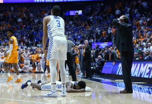 fc2275cbc As Kentucky guard Ashton Hagans (2) lies on the court after committing a  foul