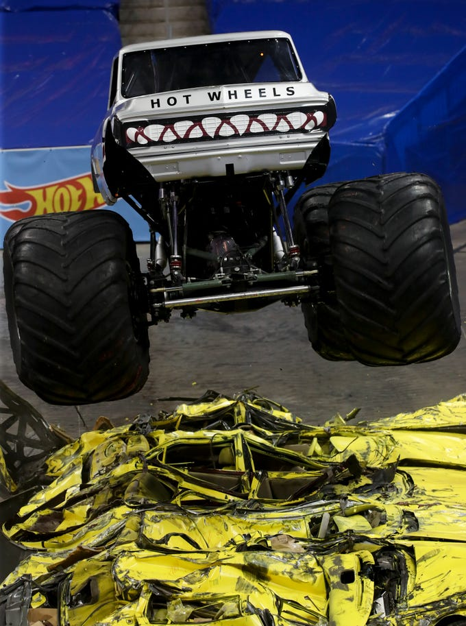 Steven Snellen, driver of V8 Bomber, entertains the crowd at the Hot Wheels Monster Trucks show at the KFC Yum Center on March 16.