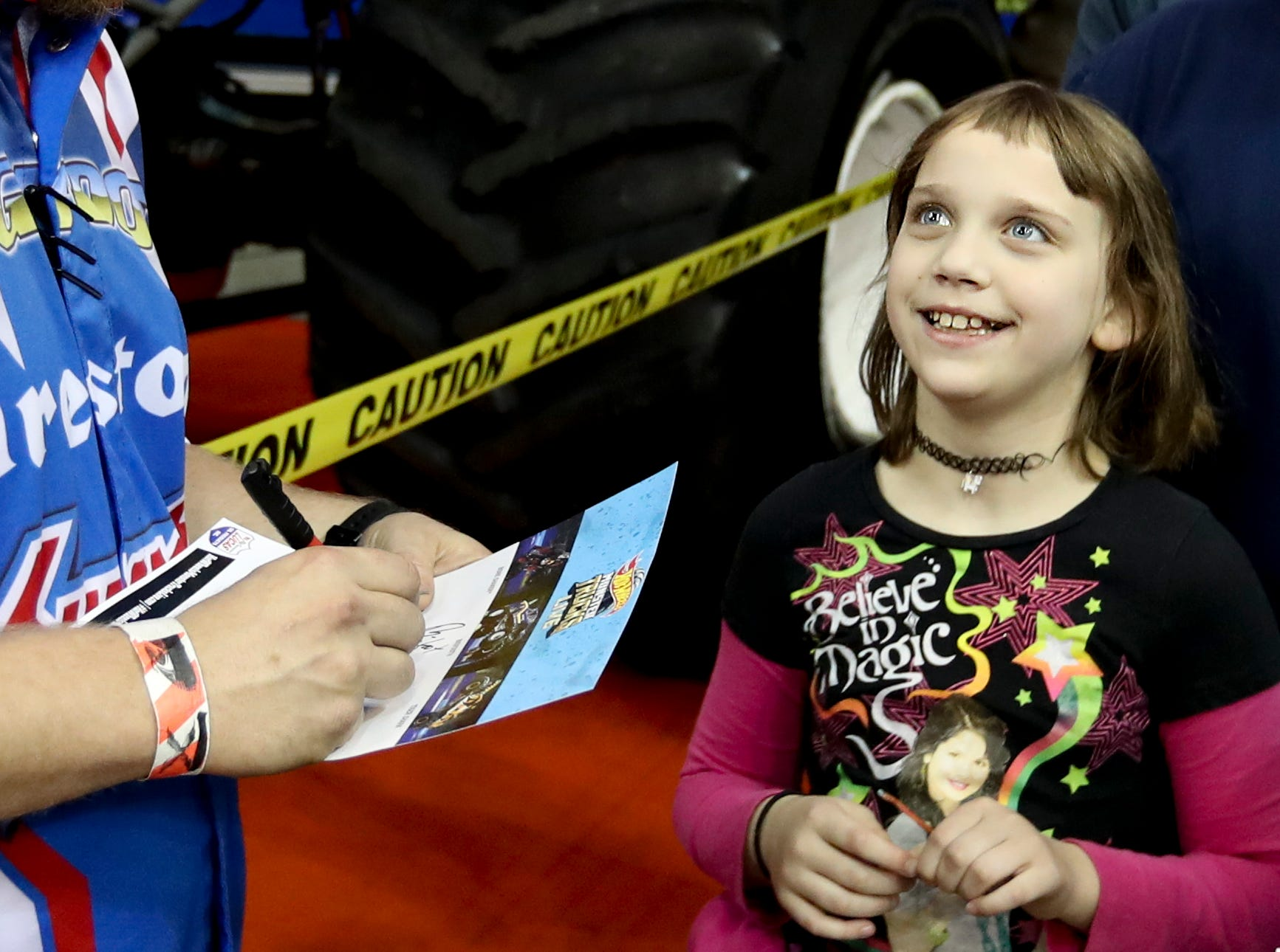 Darron Schnell, driver of Big Foot, signs autographs during the Crash Zone Party before the Hot Wheels Monster Trucks show at the KFC Yum Center on March 16.