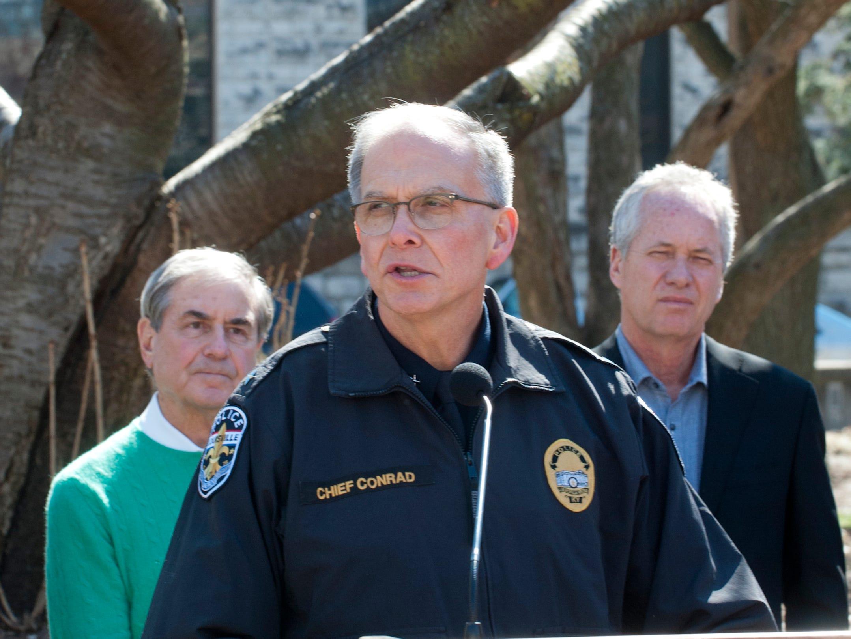 Louisville Metro Police Chief Steve Conrad speaks at the vigil as U.S. Representative John Yarmuth (D-Louisville), left, and Louisville Metro Mayor Greg Fischer, right, listen. 16 March 2019