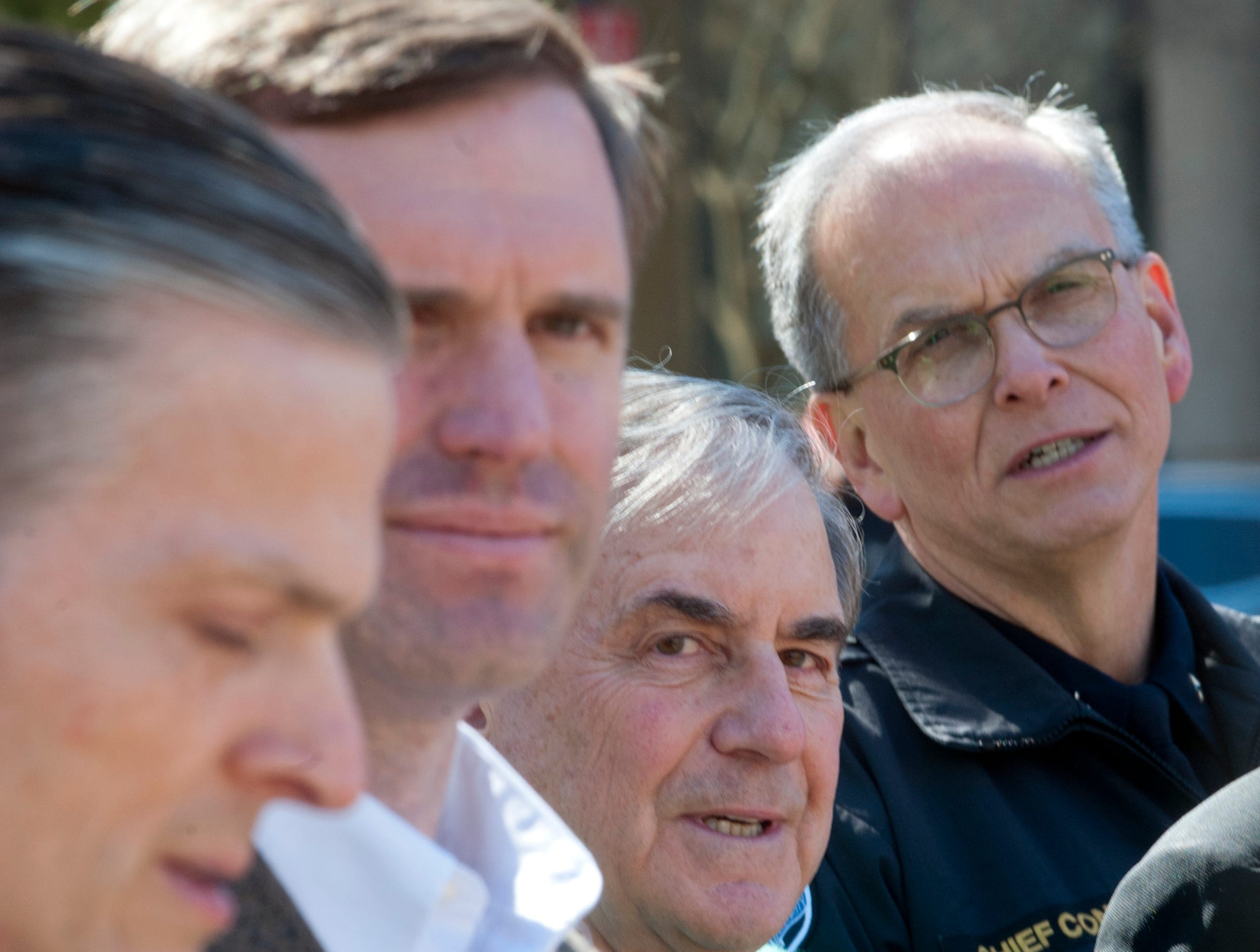 L-R: FBI Special Agent In Charge James Robert.Brown , Kentucky State Attorney General Andy Beshear, U.S. Representative John Yarmuth (D-Louisville)  and Louisville Metro Police Chief Steve Conrad listen to a speaker during the rally.