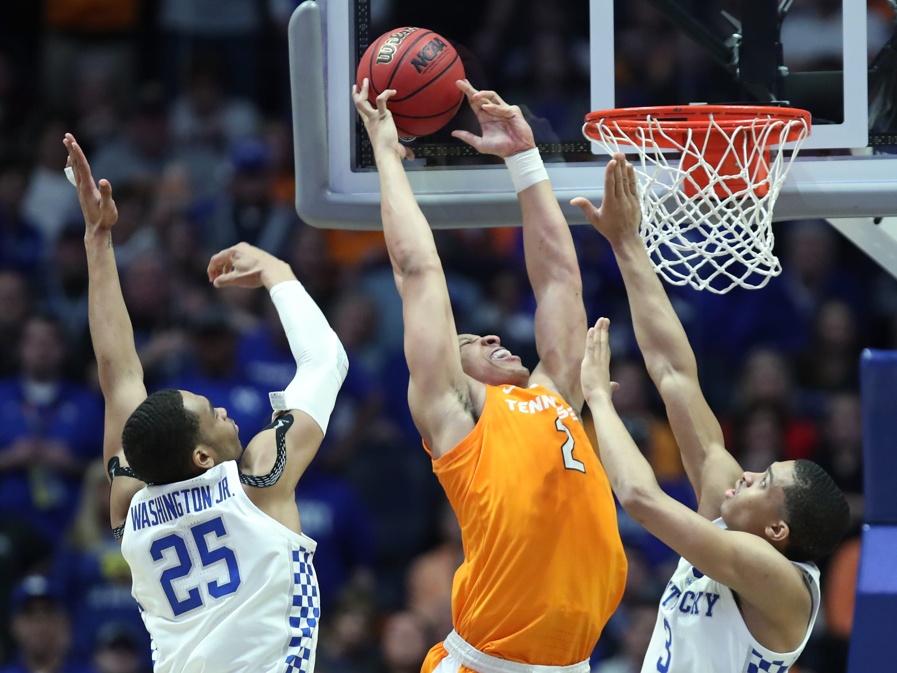 Tennessee forward Grant Williams (2) goes for two defended by Kentucky forward PJ Washington (25) and guard Keldon Johnson (3) during the second half of the SEC Men's Basketball Tournament game at Bridgestone Arena in Nashville, Tenn., Saturday, March 16, 2019.