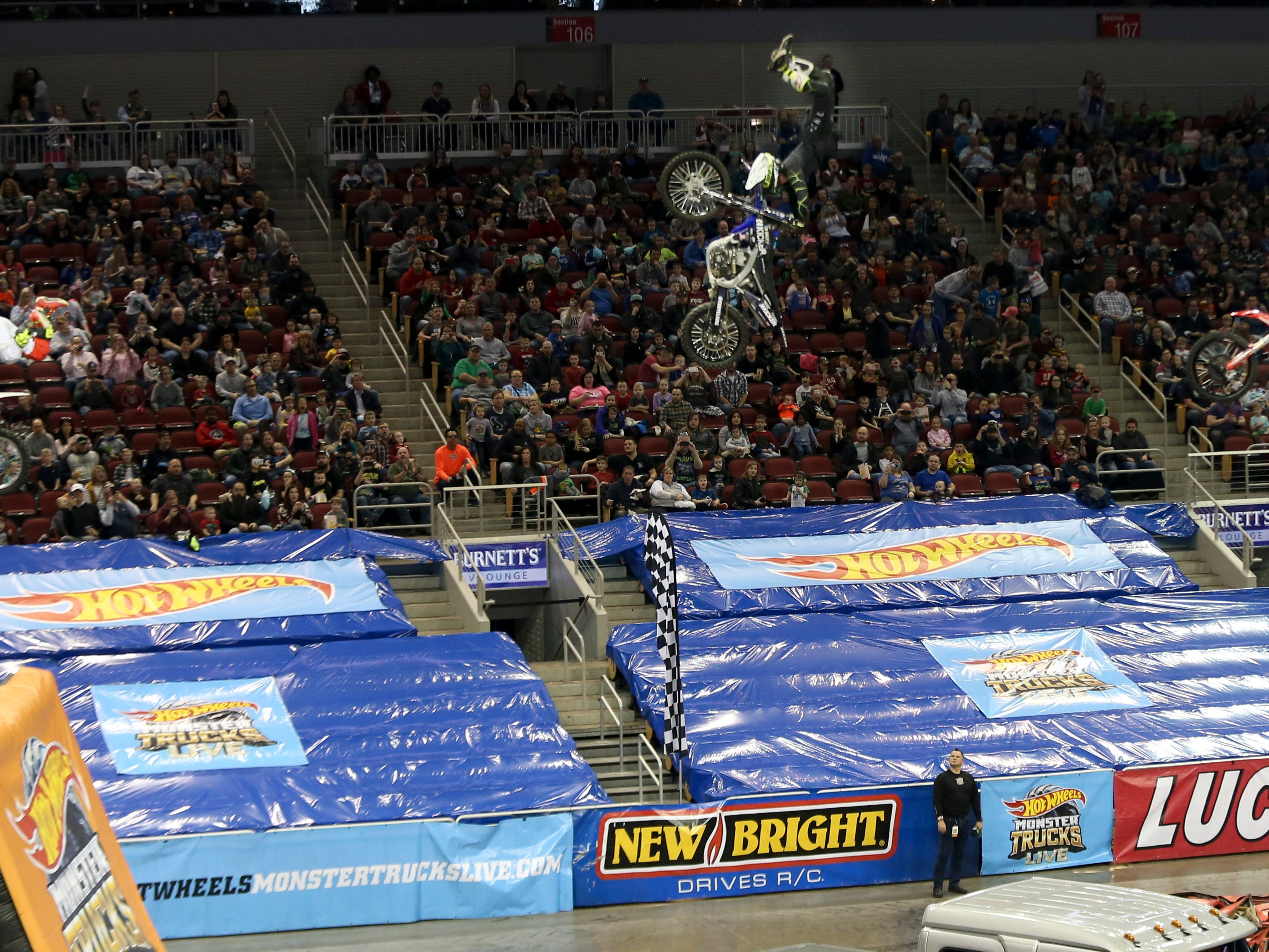 FMX riders, Brody Wilson, Cody Elkins and Josh Headford, entertain the crowd at the Hot Wheels Monster Trucks show at the KFC Yum Center on March 16.