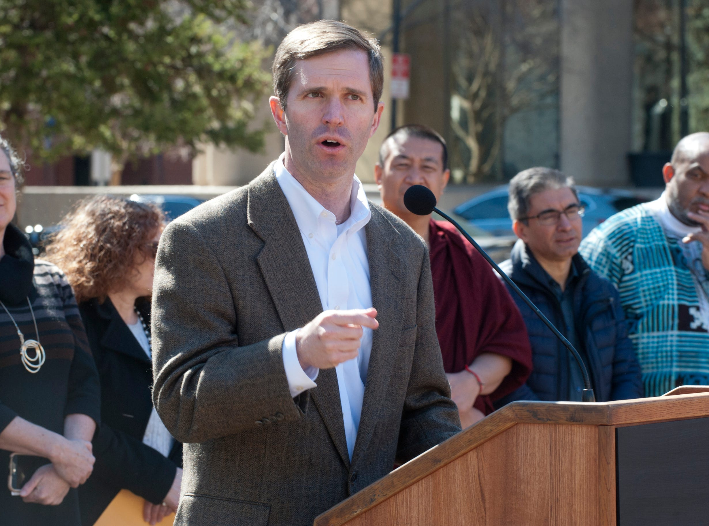 Kentucky State Attorney General Andy Beshear speaks at the vigil.