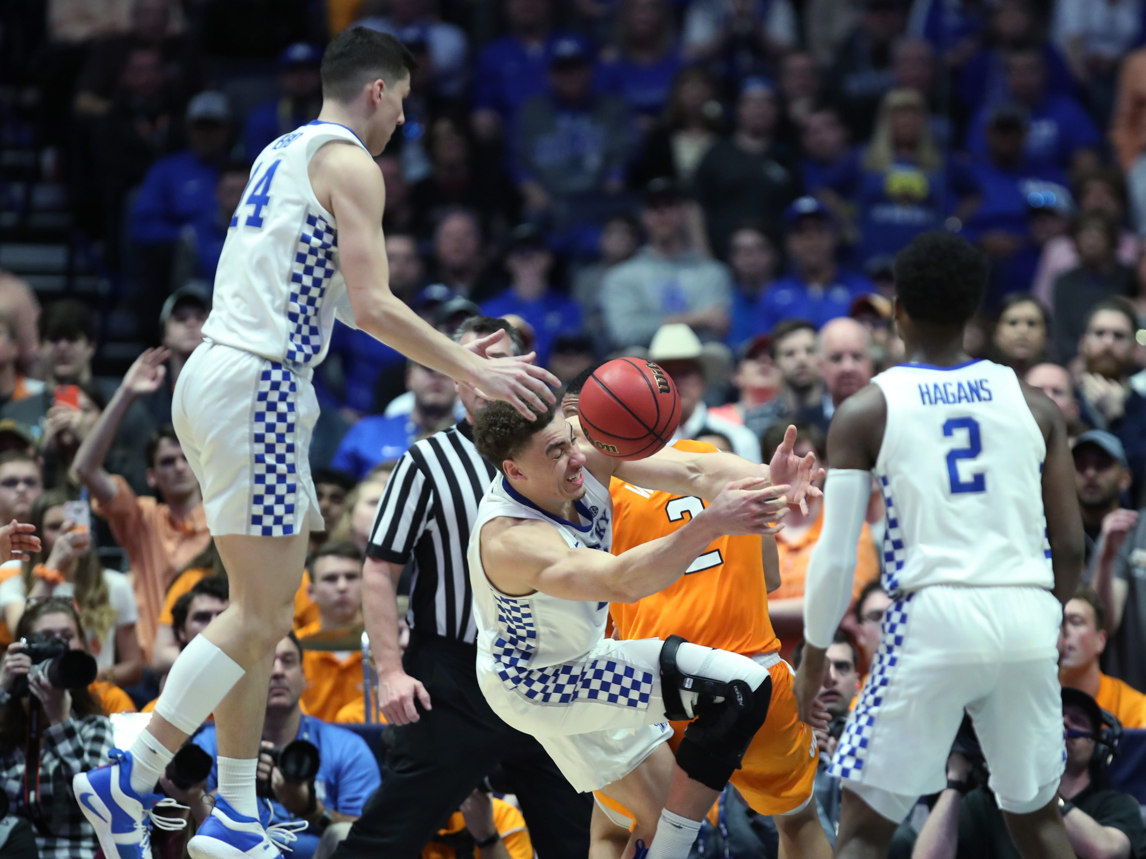 Kentucky guard Tyler Herro (14), forward Reid Travis (22) and guard Ashton Hagans (2) try to get a loose ball during the second half of the SEC Men's Basketball Tournament game against Tennessee at Bridgestone Arena in Nashville, Tenn., Saturday, March 16, 2019.