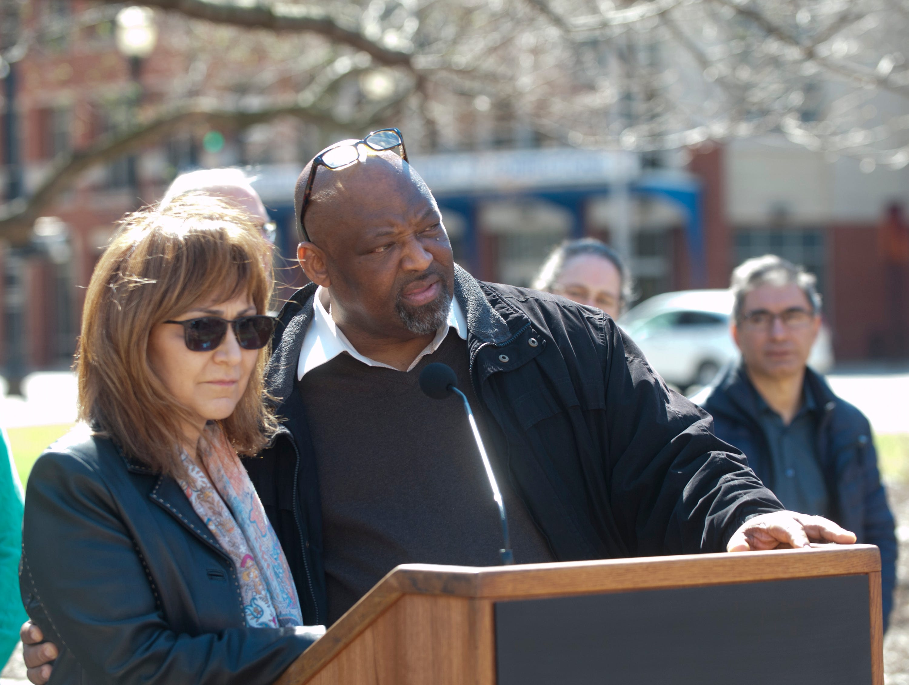 Haleh Karimi, executive director of Louisville's Interfaith Paths to Peace, left, and James Linton, president of Community Connections Group of Louisville, speak at the vigil.
