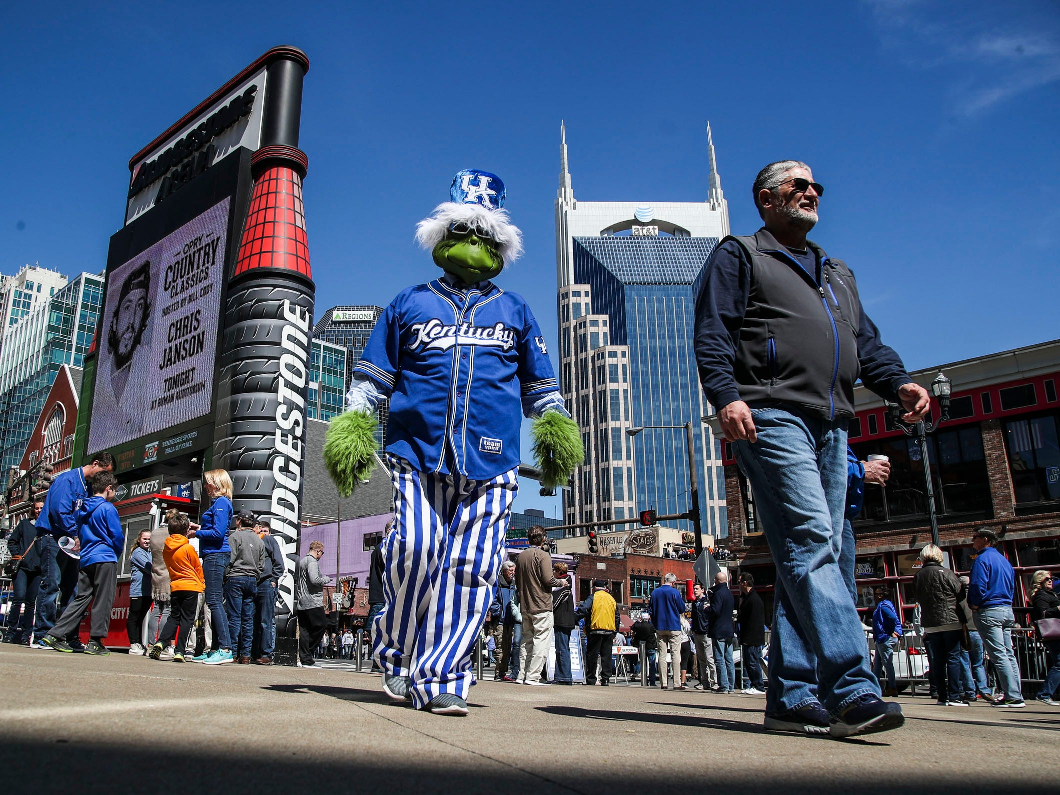 Straight from a sports version of Dr. Seuss, a Kentucky Grinch mingles outside Bridgestone Arena Saturday morning before the game against Tennessee. March 16, 2019.