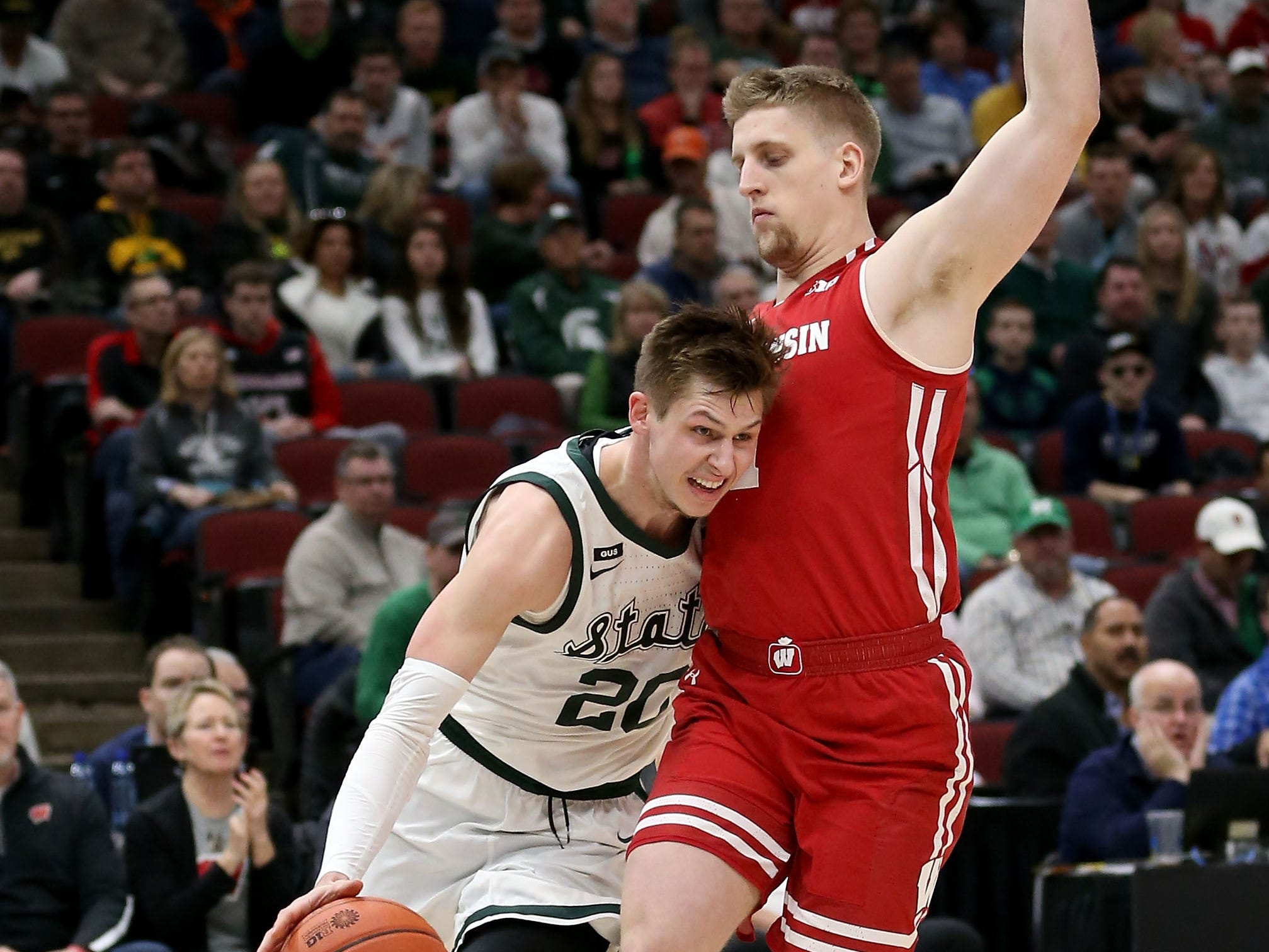 Matt McQuaid #20 of the Michigan State Spartans dribbles the ball while being guarded by Brevin Pritzl #1 of the Wisconsin Badgers in the first half during the semifinals of the Big Ten Basketball Tournament at the United Center on March 16, 2019 in Chicago, Illinois.