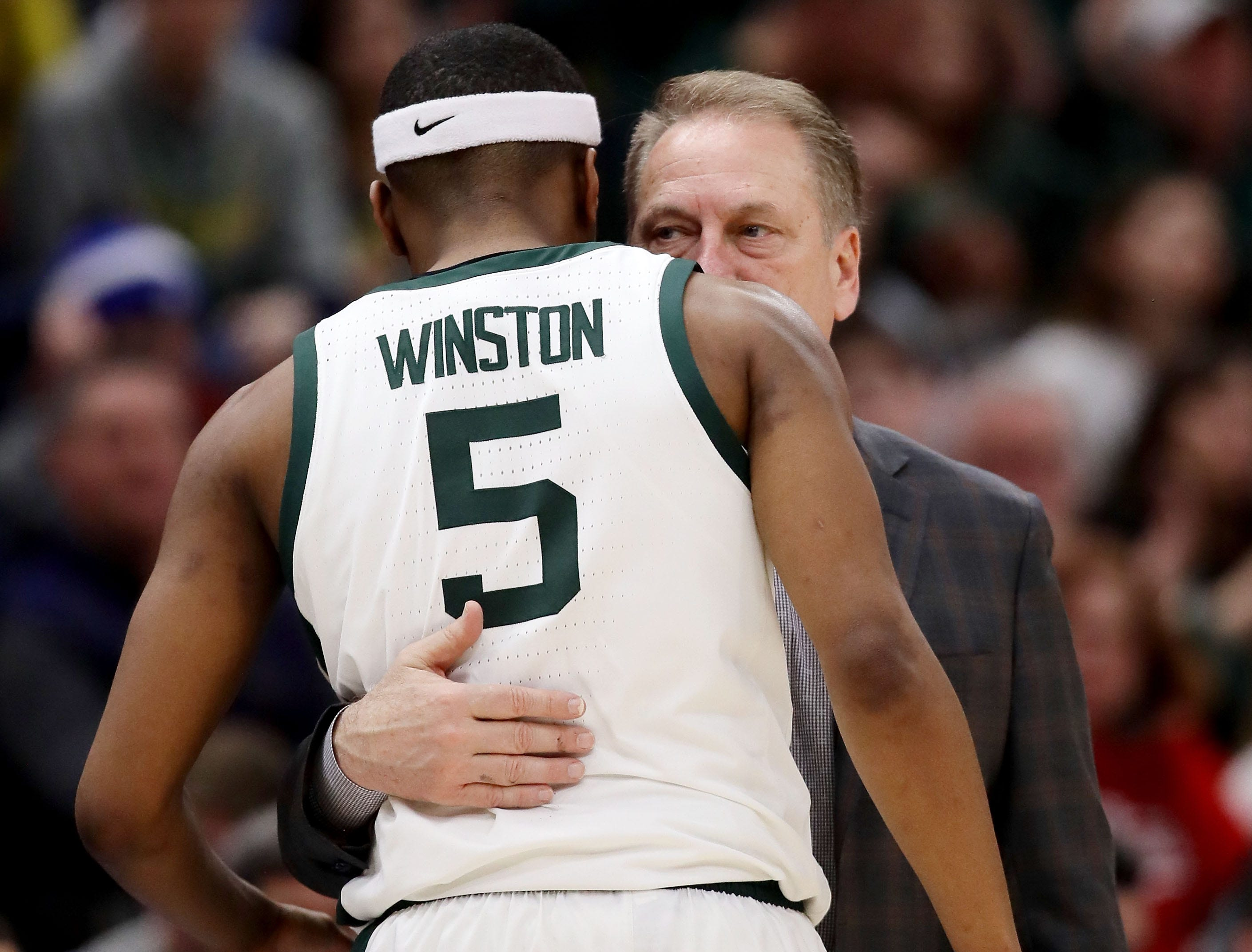 Cassius Winston #5 and head coach Tom Izzo of the Michigan State Spartans meet in the second half against the Wisconsin Badgers during the semifinals of the Big Ten Basketball Tournament at the United Center on March 16, 2019 in Chicago, Illinois.