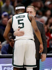Cassius Winston and Tom Izzo, hear sharing a moment late in MSU's win over Wisconsin on Saturday, have gotten the best of the Wolverines twice this season. They'll try to do so again on Sunday.