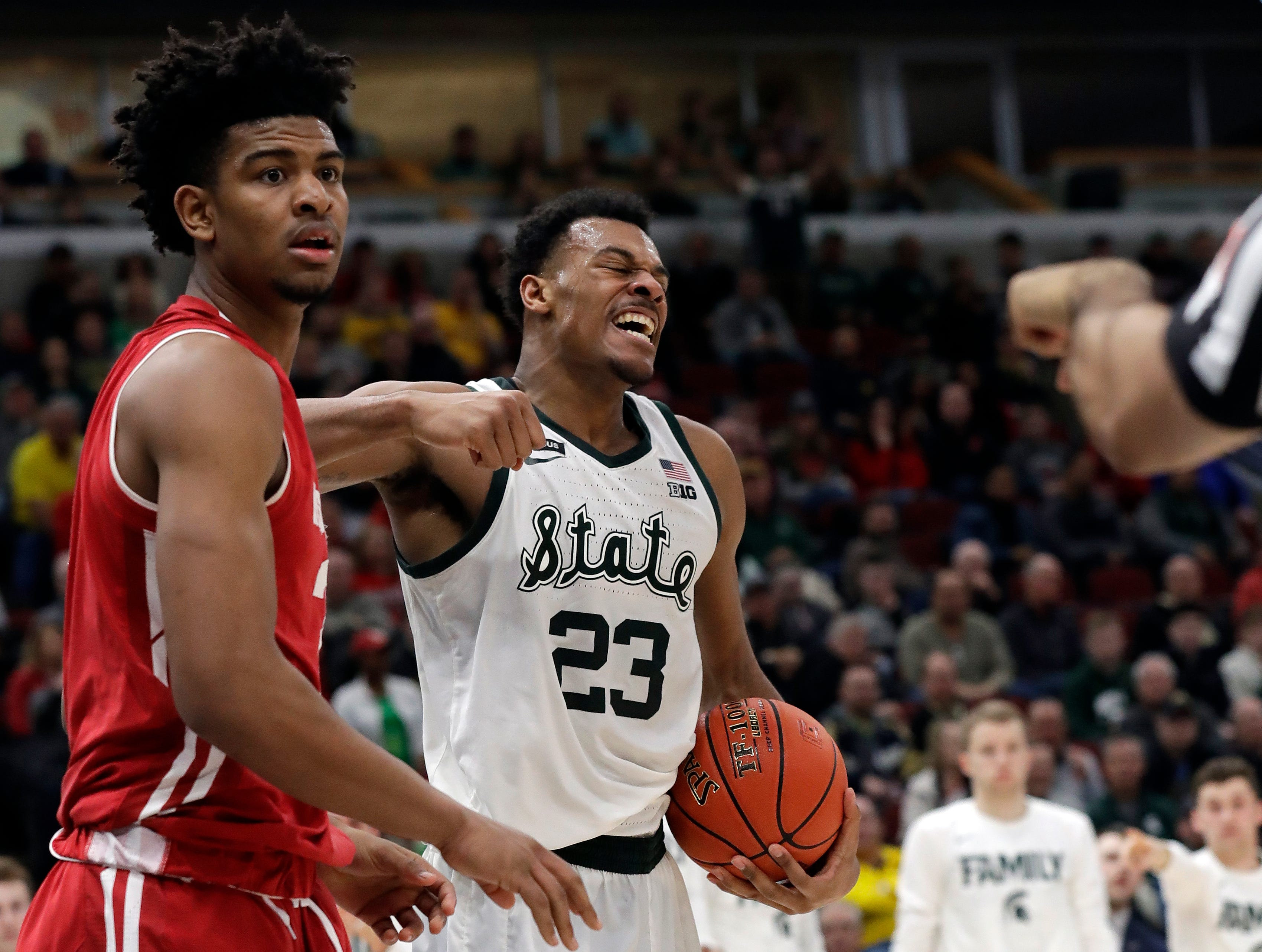 Wisconsin's Aleem Ford and Michigan State's Xavier Tillman (23) react to a call during the second half of an NCAA college basketball game in the semifinals of the Big Ten Conference tournament, Saturday, March 16, 2019, in Chicago.