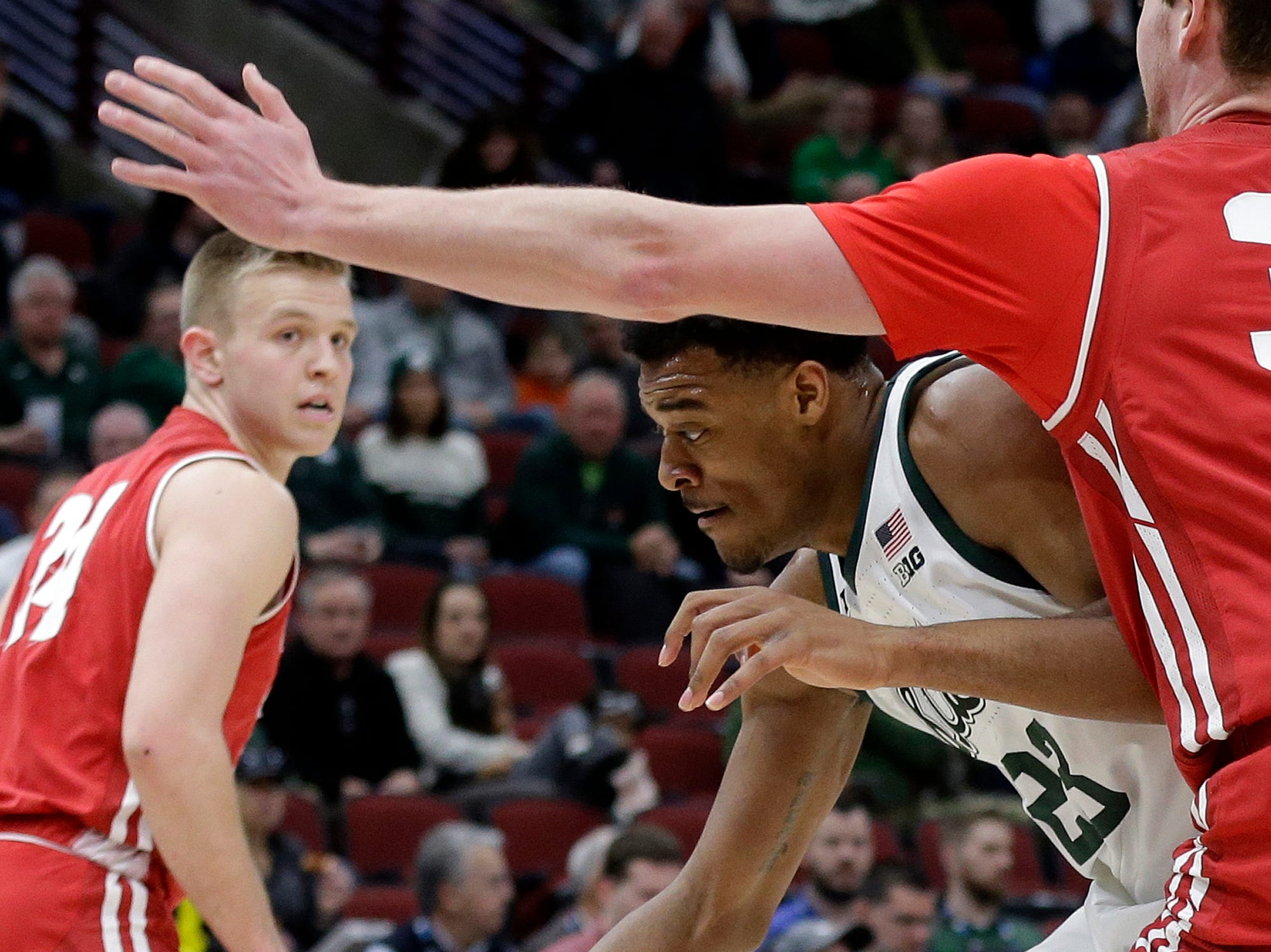 Michigan State's Xavier Tillman (23) drives against Wisconsin's Nate Reuvers during the first half of an NCAA college basketball game in the semifinals of the Big Ten Conference tournament, Saturday, March 16, 2019, in Chicago.