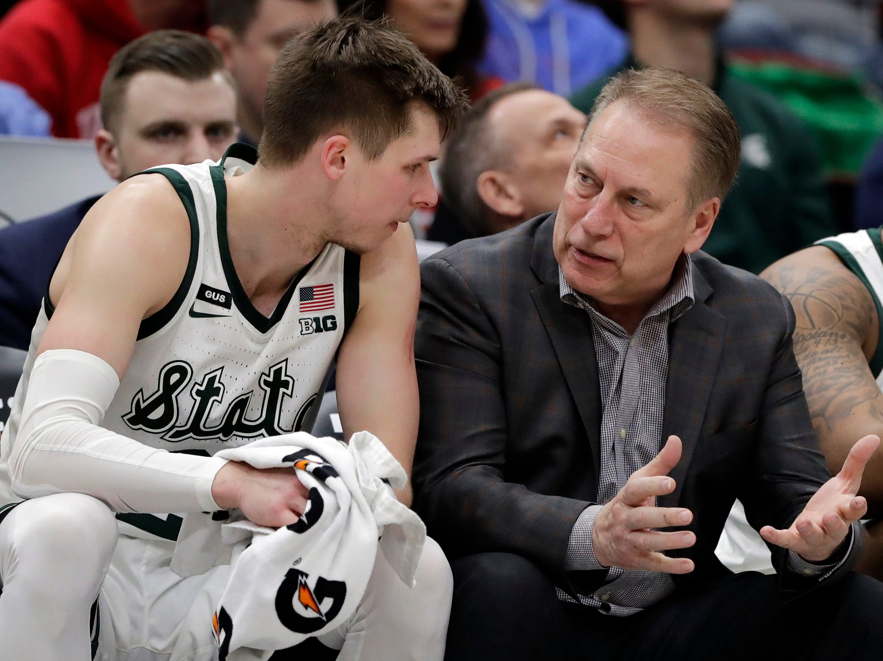 Michigan State head coach Tom Izzo talks to Matt McQuaid on the bench during the second half of an NCAA college basketball game against Wisconsin in the semifinals of the Big Ten Conference tournament, Saturday, March 16, 2019, in Chicago. Michigan State won 67-55.