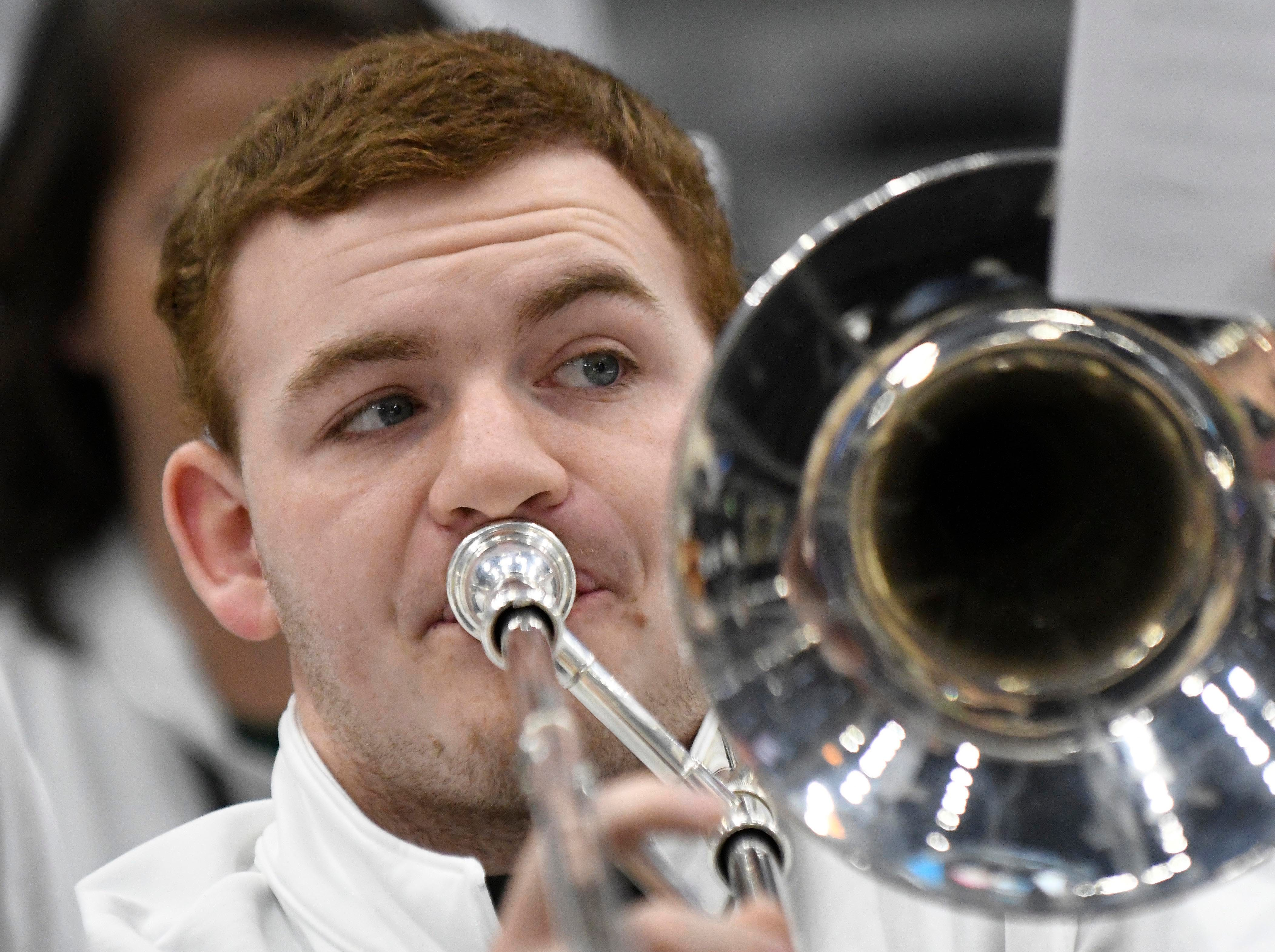 A Michigan State Spartans band member preforms prior to the game in the Big Ten conference tournament against the Wisconsin Badgers at United Center.