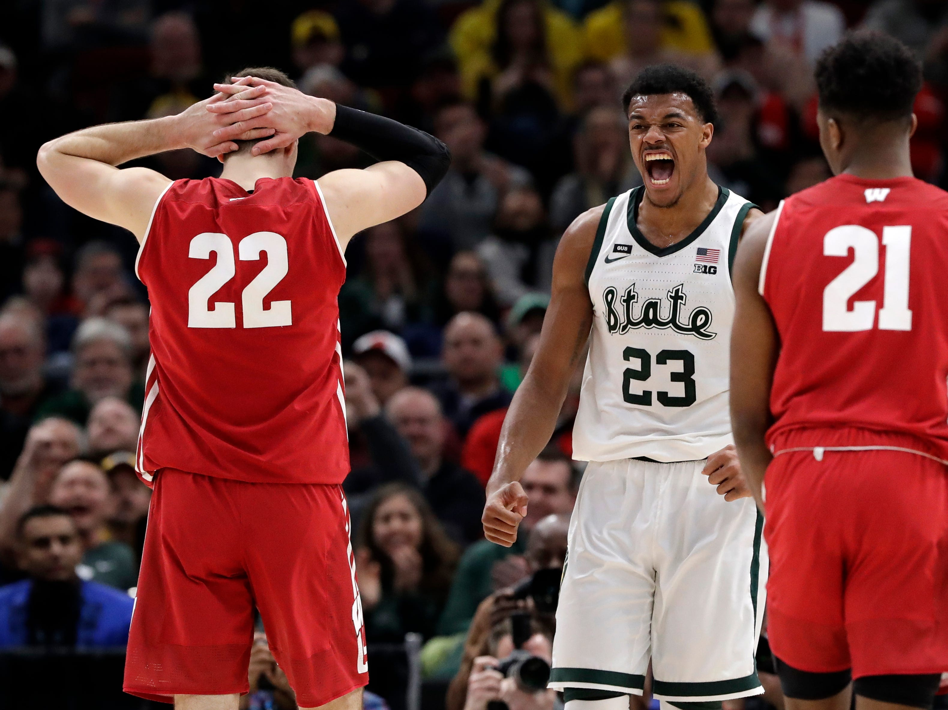 Michigan State's Xavier Tillman (23) reacts during the first half of an NCAA college basketball game against Wisconsin in the semifinals of the Big Ten Conference tournament, Saturday, March 16, 2019, in Chicago.