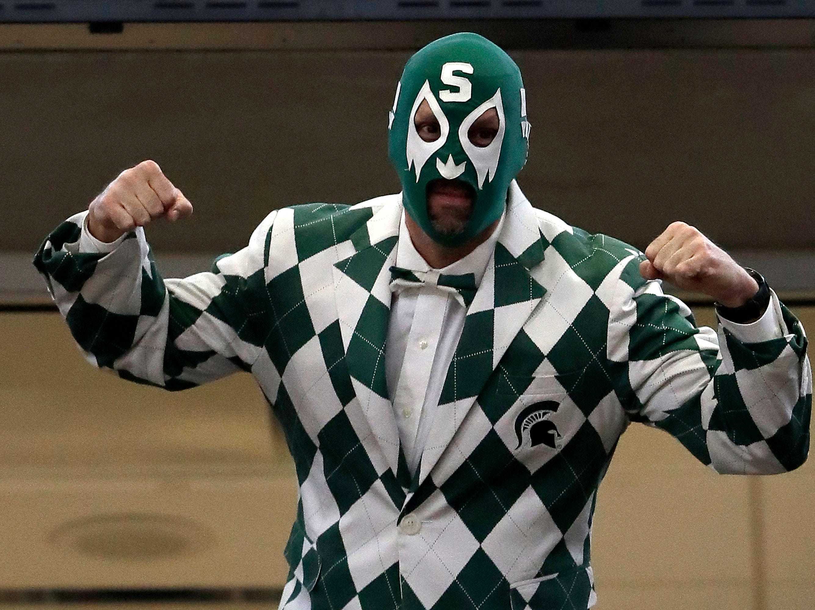 A Michigan State fan poses as he cheer during the first half of an NCAA college basketball game between Michigan State and Wisconsin in the semifinals of the Big Ten Conference tournament, Saturday, March 16, 2019, in Chicago.