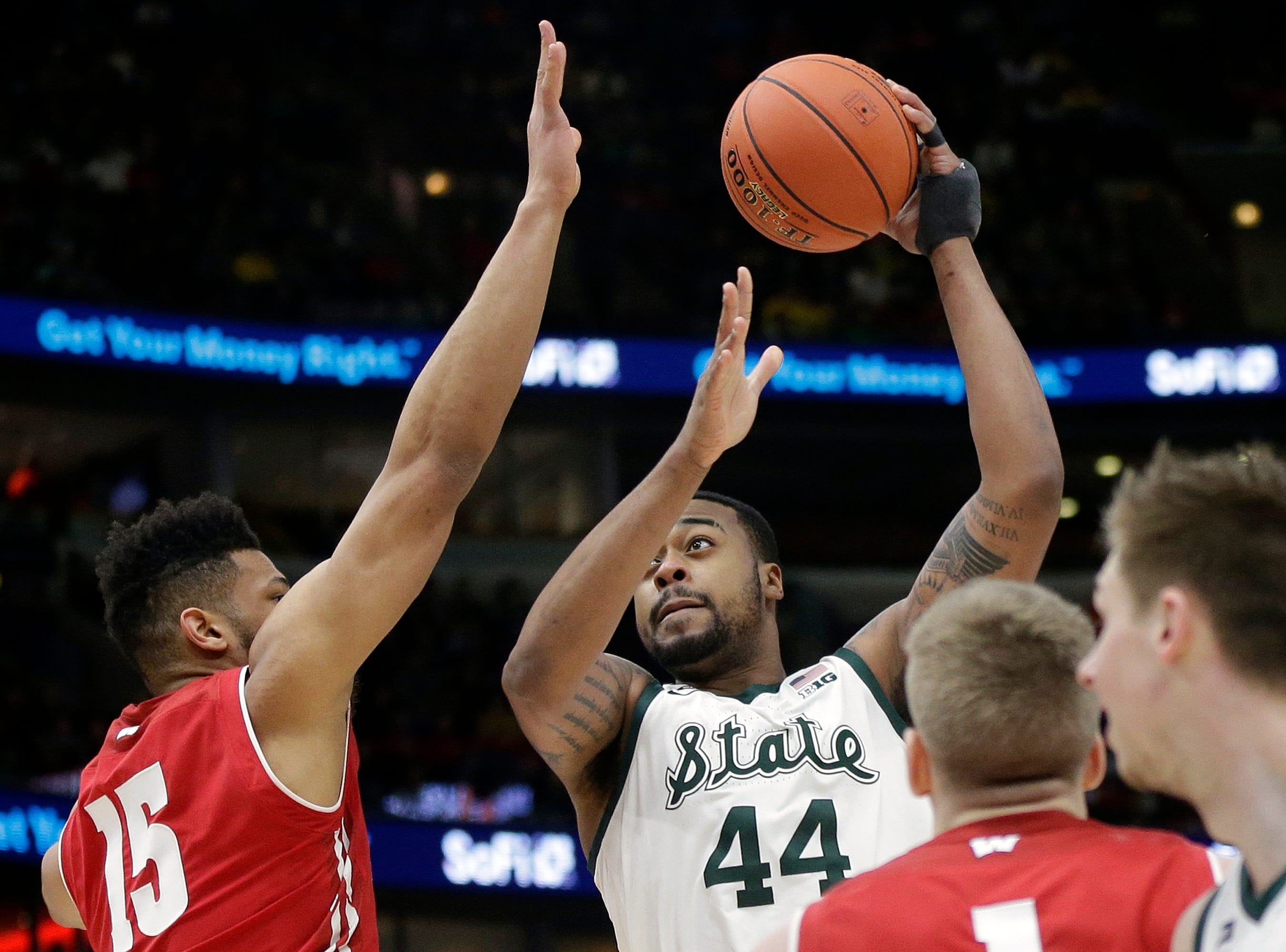 Michigan State's Nick Ward (44) takes a shot over Wisconsin's Charles Thomas IV (15) during the first half of an NCAA college basketball game in the semifinals of the Big Ten Conference tournament, Saturday, March 16, 2019, in Chicago.