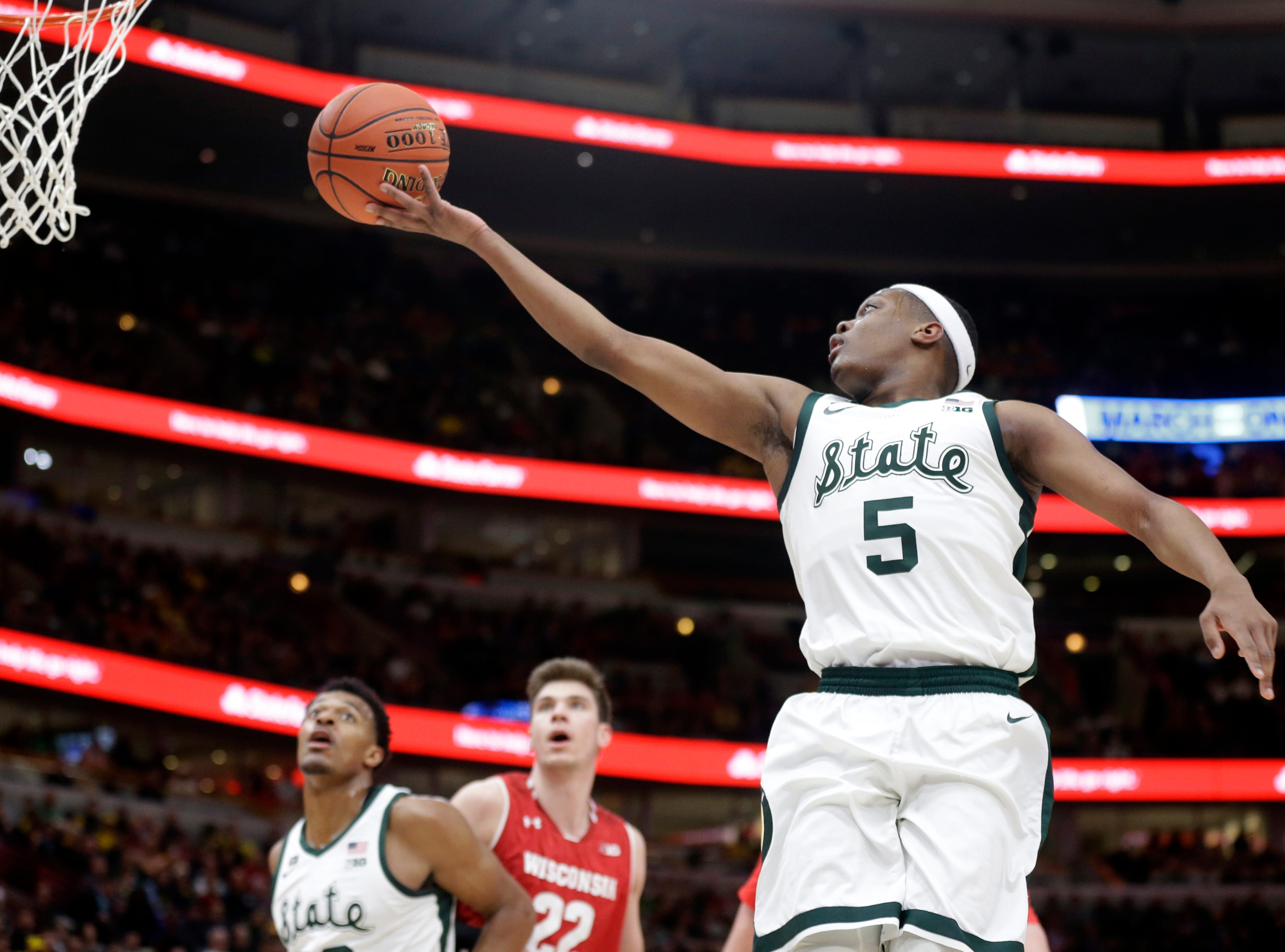Michigan State's Cassius Winston (5) goes up for a lay up during the first half of an NCAA college basketball game against Wisconsin in the semifinals of the Big Ten Conference tournament, Saturday, March 16, 2019, in Chicago.