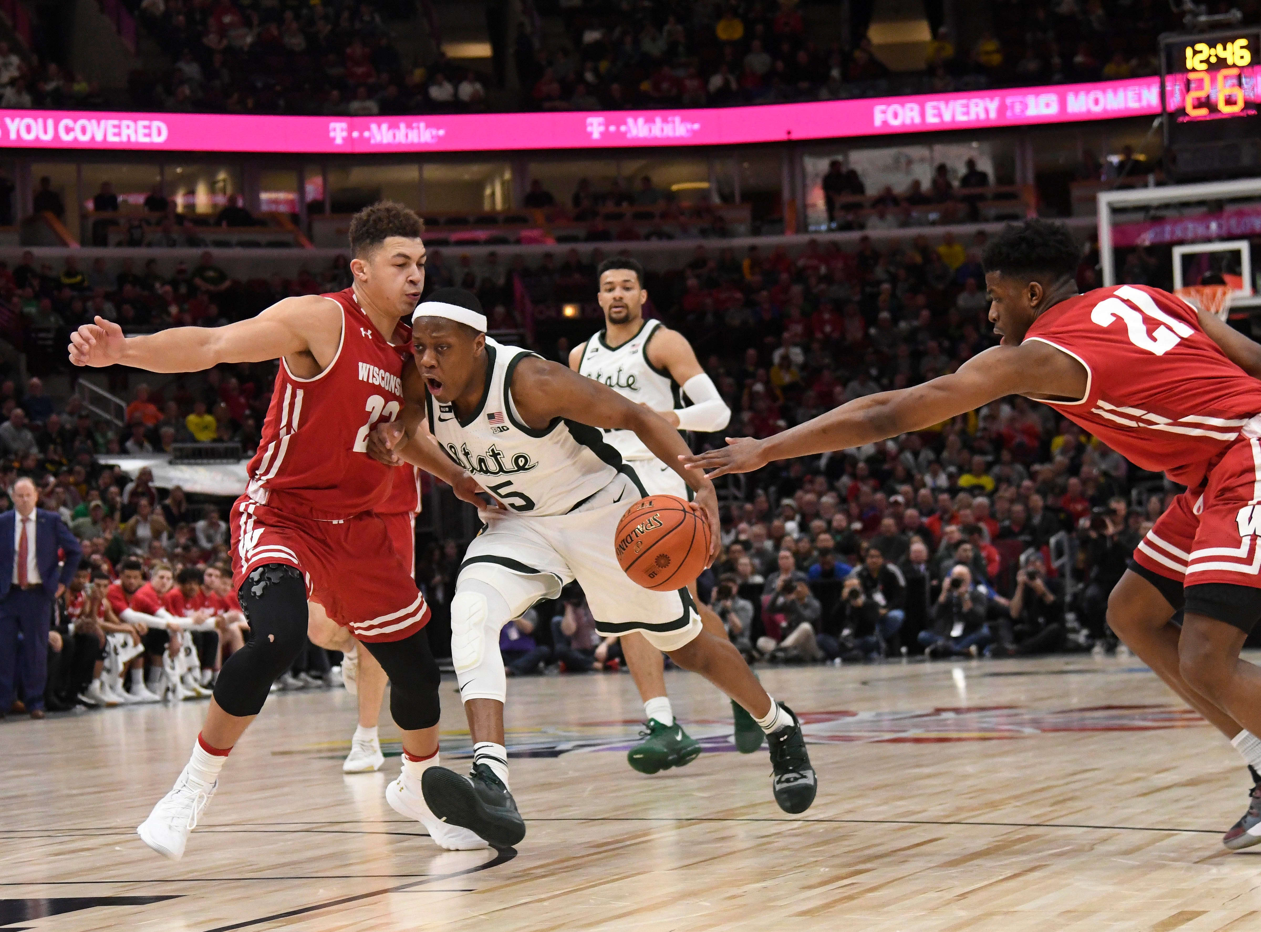 Michigan State Spartans guard Cassius Winston (5) dribbles the ball as Wisconsin Badgers guard Kobe King (23) defends during the second half in the Big Ten conference tournament at United Center.